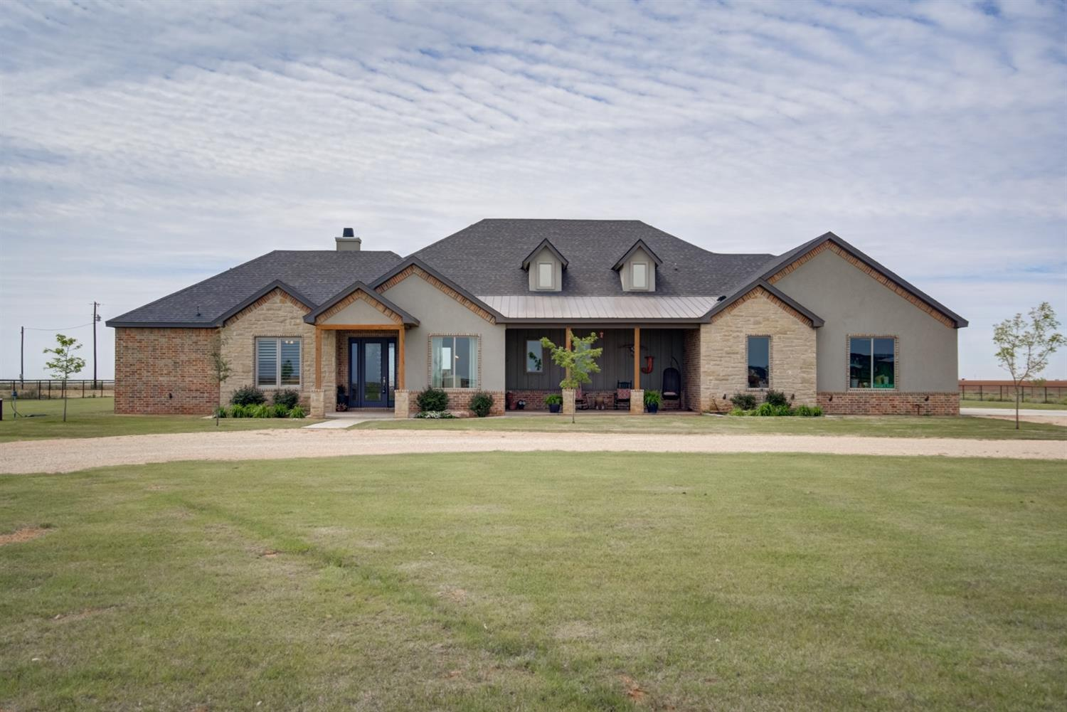 WOW!!! You will fall in love with this Amazing Home from the second you drive up!!  I also have a 360 Video for you to view!  Home is located in New Home School District. Great Location, just 3 min from school.  Home sits on 2 acres with highway frontage.  3/3/3 with office. Some features of this home, Oversized 3 car garage, office, pipe fence all around, great porches, great storage, huge closets, mudroom, laundry room off the master closet, beautiful windows, great views, bar/coffee serving area to patio, amazing brick wall and so much more.  Let me tell you about this Kitchen~ Cooks Dream! huge Bar/ Island,  tons of cabinets, gas cooktop,2 ovens, built-in side by side fridge all stainless, Has a Butler's Pantry that is like a 2nd Kitchen, great prep area, sink and tons of countertop area and cabinets. Isolated Master BR with Amazing Bathroom and HUGE Closet. All bedrooms have large walk-in closets! Jack-n-jill BR . 1/2 bath for quest. Foam Insulation,Plantation Shutters.