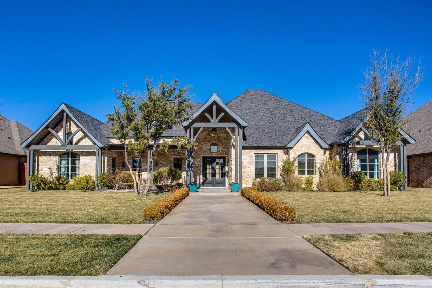 Phenomenal four bedroom home located in Oakmont Estates!  This home was custom built by Clearview Custom Homes and was featured in the Parade of Homes.  The opulent living room has soaring ceilings, gas logs fireplace and a wet bar. The kitchen features top of the line appliances including a built-in commercial sized fridge/freezer, 6 burner gas stove, and a large island. The gorgeous isolated master suite has a cathedral ceiling with a built-in TV, air flow tub, his and her vanities, separate walk-in shower and sauna, and a massive closet with a designated dressing area finish off the master suite.  There is a small play area directly outside two of the additional bedrooms that is easily closed off with a sliding door.  Walk down the oversized stairway to a large basement or venture to the back patio where you will find an amazing covered area and with an outdoor fireplace/Kitchen. There is a trophy/game room in the back that is a great place to entertain! Welcome to your dream home!