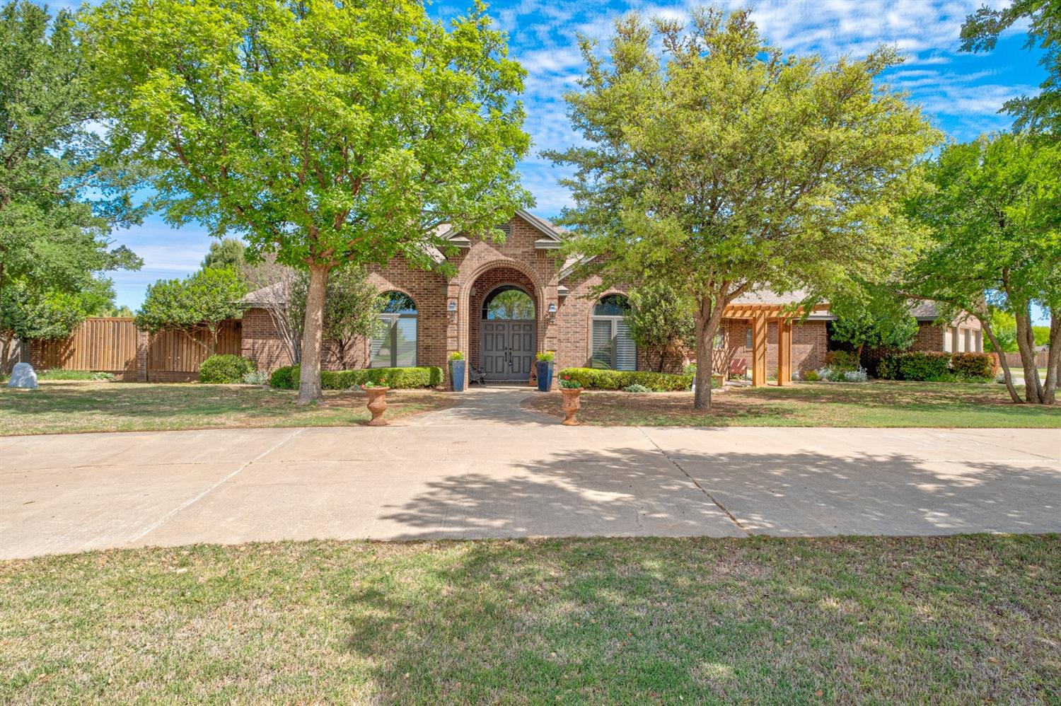 This 4/3/3 Kemper Estates Beauty on 1 Acre has ALL the bells and whistles! Impressive details are everywhere ~ Large open family spaces, Tall vaulted ceilings, THREE stone fireplaces, +++! HUGE Master bedroom Suite with doors to back patio. Master bath has separate vanities, large shower & airflow tub, PLUS a closet as big as a bedroom! Bedrooms #2 & #3 have a Jack and Jill bath in between. The 4th bedroom has an entire wall of built-ins ~ could be a great office. Nice laundry room, Safe room, 2 dining rooms, and TONS of windows with an abundance of natural light. Landscaped with care, the front and back yards are amazing - The Large covered patio features an Outdoor kitchen, and the Hot tub/Spa & Inground pool will offer relaxation and FUN for all! 40x30 barn features an upstairs gameroom with 1/2 bath (BONUS square footage!) with deck overlooking the pool PLUS another shop is currently being used as a workout facility. THIS HOME HAS IT ALL!!  ** Brand New HVAC - Lifetime Warranty! **