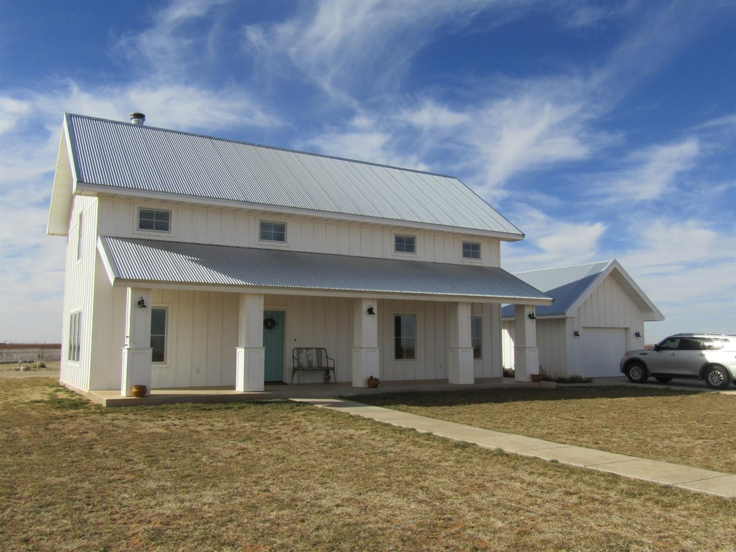 Adorable Two-Story, Modern Farm House on 3.5 Acres!  Located on 3.5 acres Southwest of Levelland with paved access.  This custom built home is only 4 years old and offers a beautifully unique style plus tall ceilings, large windows and  open spaces. 3 bedrooms, 3 bathrooms with large kitchen offering stainless appliances, island, gas range and lots of storage. There is a finished basement and a unfinished bonus room upstairs that could be 4th bedroom, den or gameroom.  Also features high efficiency HVAC system, foam insulation, double pane windows, water softner and much more. The acreage is fenced and cross fenced with 1120 SF barn and guest house, lawn sprinkler, drip irrigation and much more!  Make an appointment to see it before someone else snatches it up!