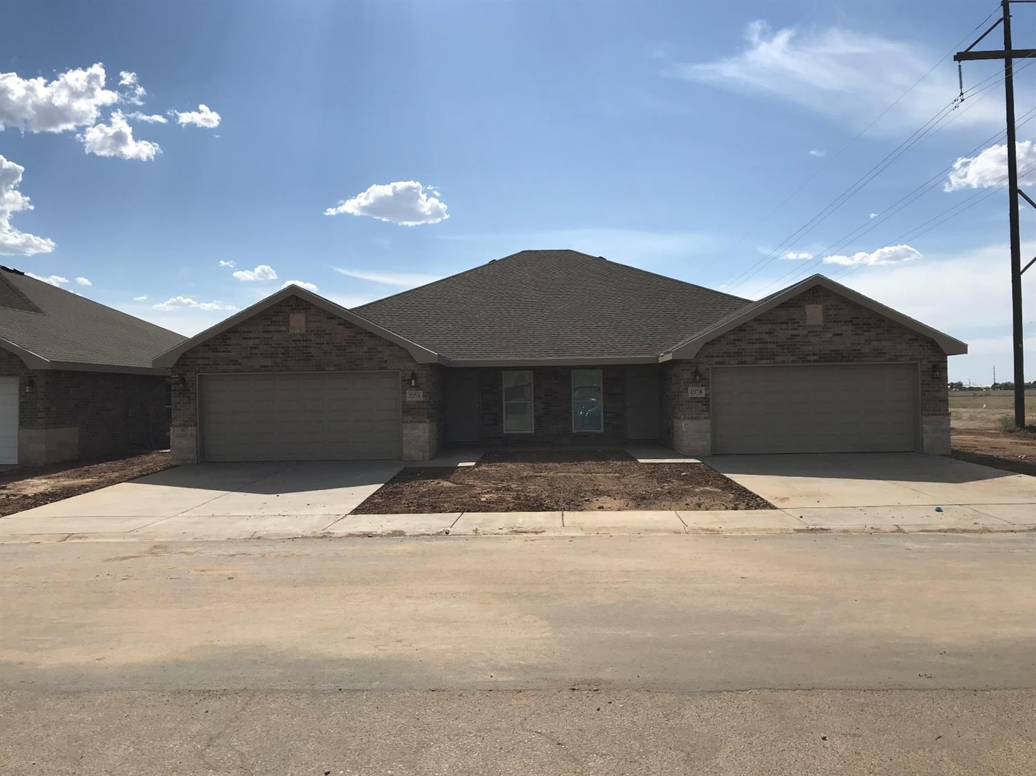 This property is a town home with two units you can buy either side or both together.  Great investment or student housing 3 bed 2 bad with office area and 2 car garage