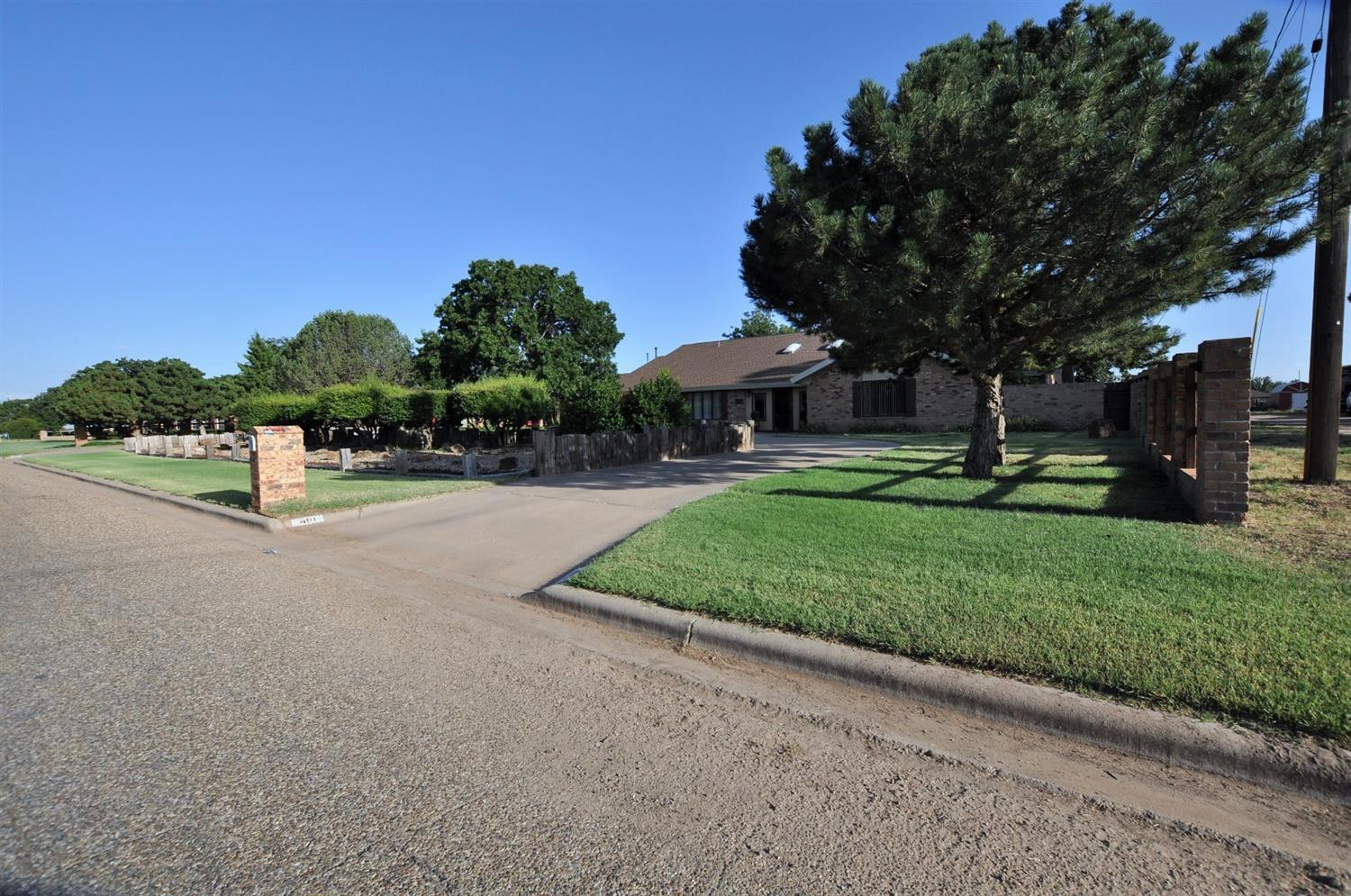 Beautiful 4054 sf. home on 1 acre of land. All rooms are very spacious. 3 bedrooms, 2 1/2 bath, 2 dining areas, office, huge basement, large 25 X 50 shop with 2 overhead doors (large enough to store big camper). Shop has dumping station. Kitchen features granite counter tops, dishwasher, garbage disposal, trash compactor, built in rangetop, new microwave and oven. Backyard is fenced and has an awesome pool recently installed, covered porch, mature trees, nice shed and sprinkler system. Lots of parking area including RV or trailer parking. This home is a must see! Call today to schedule your private tour.