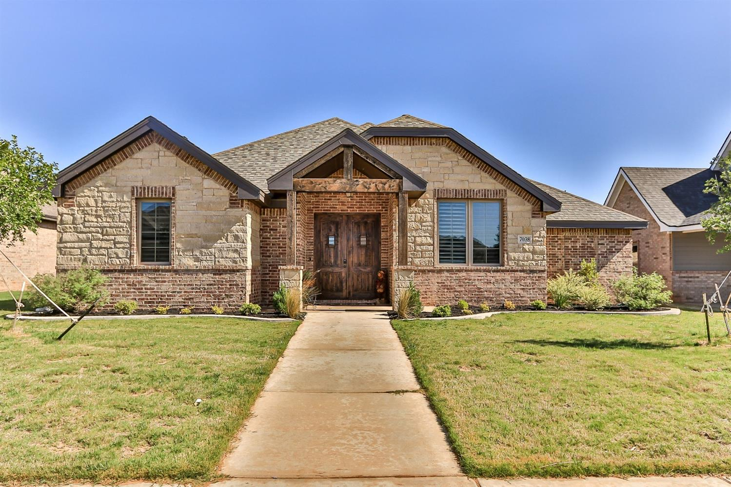 The beautiful 4/3.5/2 in Frenship ISD you have been waiting to own. Located on cul-de-sac at The Ridge in Frenship ISD. Kitchen features beautiful cabinetry, Whirlpool Gold double ovens (one is convection), gas range, and a beautiful quartz island. An open-concept living allows vision to an inviting brick FP in the living room. Notice the gorgeous light fixtures in home. Outside there is a perfectly placed shaded patio with tv & mount. Features include: Alexa capable to turn on under cabinet lighting & laundry room. The desk in living room is easily moveable and has been the perfect spot for kids doing homework. Master is isolated with large closet, stunning shower, and separate vanity areas. Bedrooms 2 & 3 share a Jack and Jill bathroom. Bedroom 4 is isolated from all others and adjacent to a full size bathroom. Near the laundry room is mudroom, pantry, and a 1/2 bath. NEST thermostat, doorbell, TV & mount in oversized garage, bike racks, wall exercise convey. Sod allowance of $1,000.