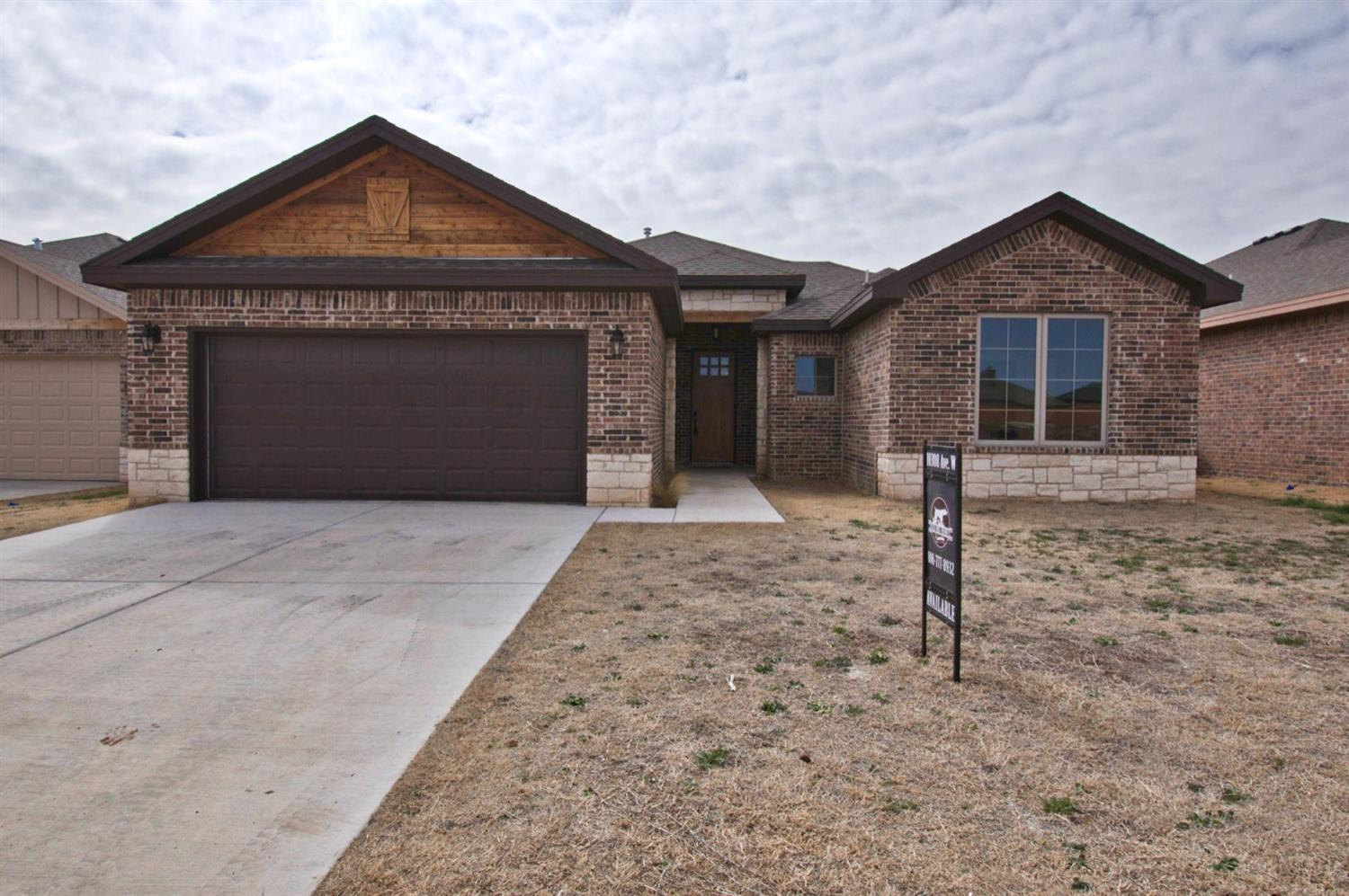 A Beautiful New Build by Bird Dog Homes! This 3/2/2 has every detail. This rustic style home has a warm neutral palette complete with a built in wine bar, custom cabinets, open beam ceiling and complete tile surrounds in the bathrooms. Great closet sizes with master closet connecting to the laundry room. Don't pass this new build up! A definite must see!