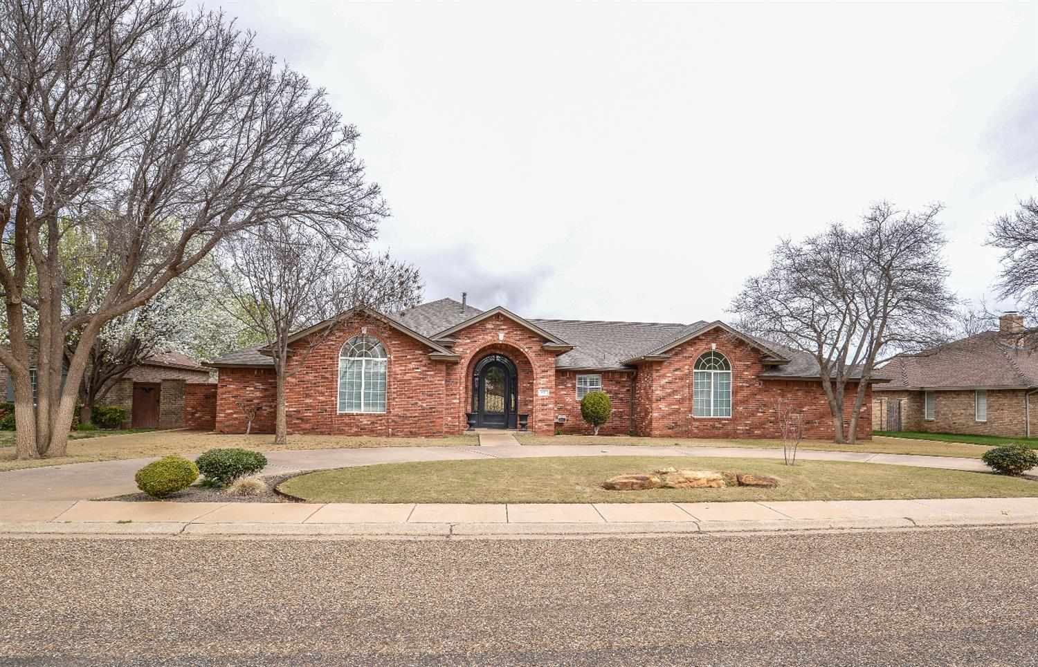 Welcome HOME! This incredible 4/3/3 is located in one of Levelland's most sought after neighborhoods, Ridgecrest. With over 2900 square feet there is plenty of room for the whole family. All bedrooms are large with built ins, and the garage even has an extra space that would be perfect as a small man cave or work space. The entire home boasts pride of ownership with upgrades like real wood flooring, granite in the kitchen, a huge master bedroom, shutters, an AMAZING iron door from Adoring Doors, a water softener, reverse osmosis system, a small barn in the back, and an incredible outdoor space with a covered patio and pergola! This home is in pristine condition, and priced just right, come check it out today!