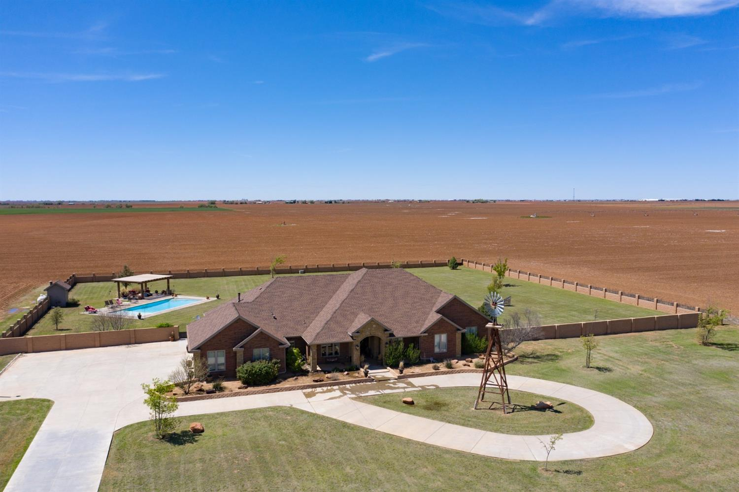 Country Living at its finest with breathtaking sunrise and sunset views for miles.  This custom one owner home located on 3 acres has 2 large living areas plus a study and a basement/media room, salt water bahama beach pool, five bedrooms 4 baths, built in dressers in closets, 3 car oversized garage, 3 fireplaces,Backyard has cinder block fence.  Conveniently located just west of Buena Vista Estates with future easy access the new loop 88.