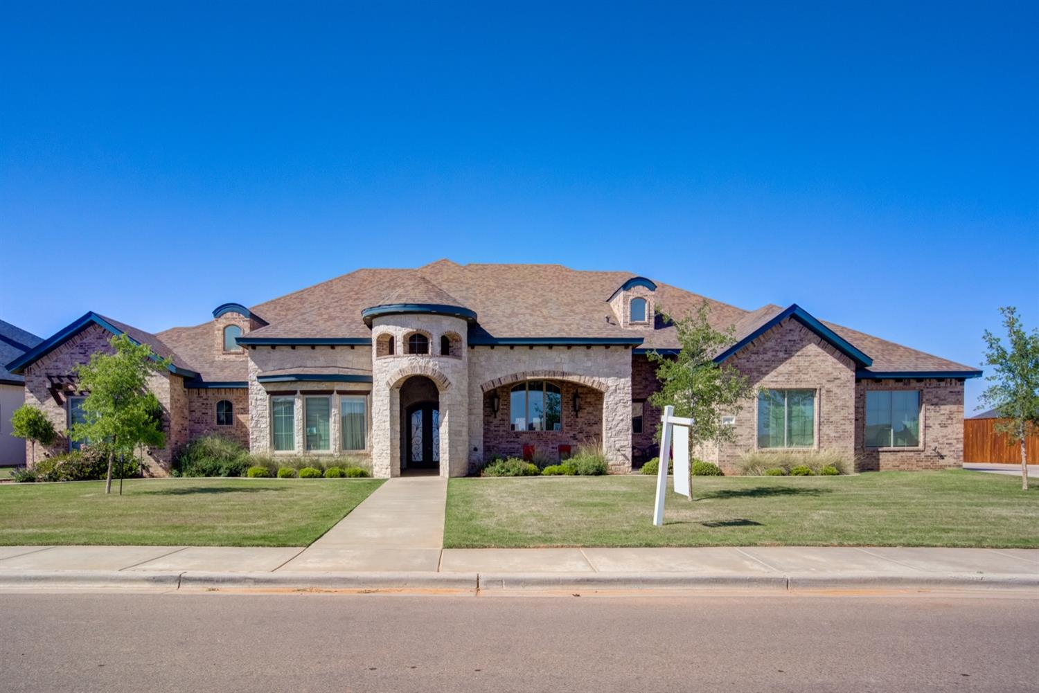 Stunning Parade Home located in the Estates at Kelsey Park.  This home offers all the custom features the luxury buyer desires all on a half acre lot in award winning Lubbock Cooper ISD.  The brick and stone exterior with cedar accents welcomes you to a dramatic entry way and an open concept floorplan designed for entertaining.  You'll find wood floors, soaring ceilings with beams and custom finishes throughout. The dream kitchen boasts two islands, double ovens, gas cooktop, working pantry and entertainment bar.  The living area offers a cozy fireplace with sweeping views of the outdoor living.  An isolated Master suite offers a retreat complete with fireplace, spa-like Master bath and huge closet with safe room.  Each additional bedroom offers an en-suite bath.  A private study is tucked away near the well appointed laundry room.  The outdoor space is perfect for enjoying sunsets or time with the family.  Additional features include a well and foam insulation to keep utilities low.