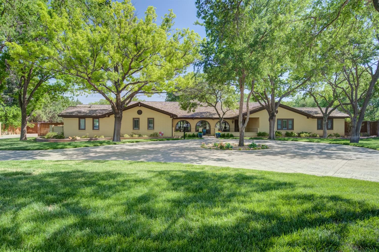 Charmaing home on 1.6 acre.Grand home -5 bedrooms 4.5 baths, 3 car garage, Basement 35x15 plus private bedroom & bath.Gorgeous 20x50 atrium  room overlooks lush backyard w/ lovely pool w/waterfall & beautiful landscaping.RV barn 50x20 with full bathroom. additional Workshop w/garage located at back lot.