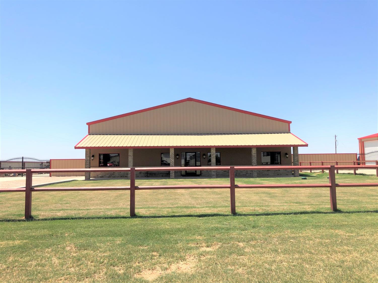 Move in Ready Office and Warehouse. New construction in 2018. Situated on 1 acre fenced stack lot with crushed rock. 3-14' Overhead Doors. Private well and septic. 30-50 Amp service with Full Water RV Hookups. Outside of City Limits. 4,800 sq ft. Build-out complete with offices, conference room, show room, break room, kitchenettes, granite throughout, insulated shop, epoxy concrete floors, secured stacked yard, quality construction throughout. LED lights in warehouse, 9,000 pound lift, additional barn storage in yard. Irrigation for front yard.