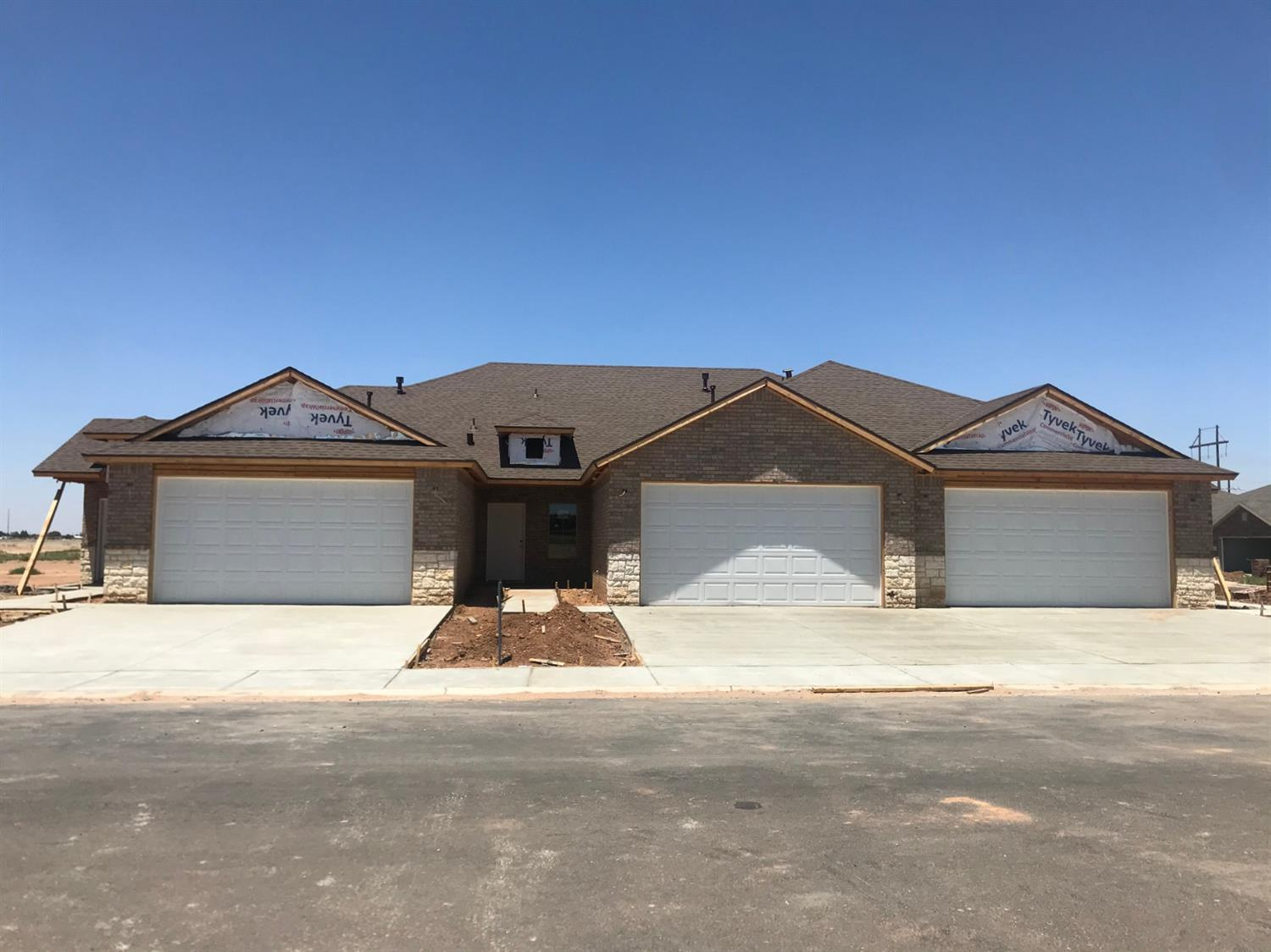 NEW CONSTRUCTION Townhomes to be completed Mid-July.2/2/2 Move-in ready! Granite Countertops, Vinyl plank floors with tile in restrooms and carpet in bedrooms. Metal facia siding, fenced backyard with sod and sprinkler system, artificial turf in front yard. These townhomes are a great location close to TTU, Medical District, restaurants and shopping!! Come and take a look today!!