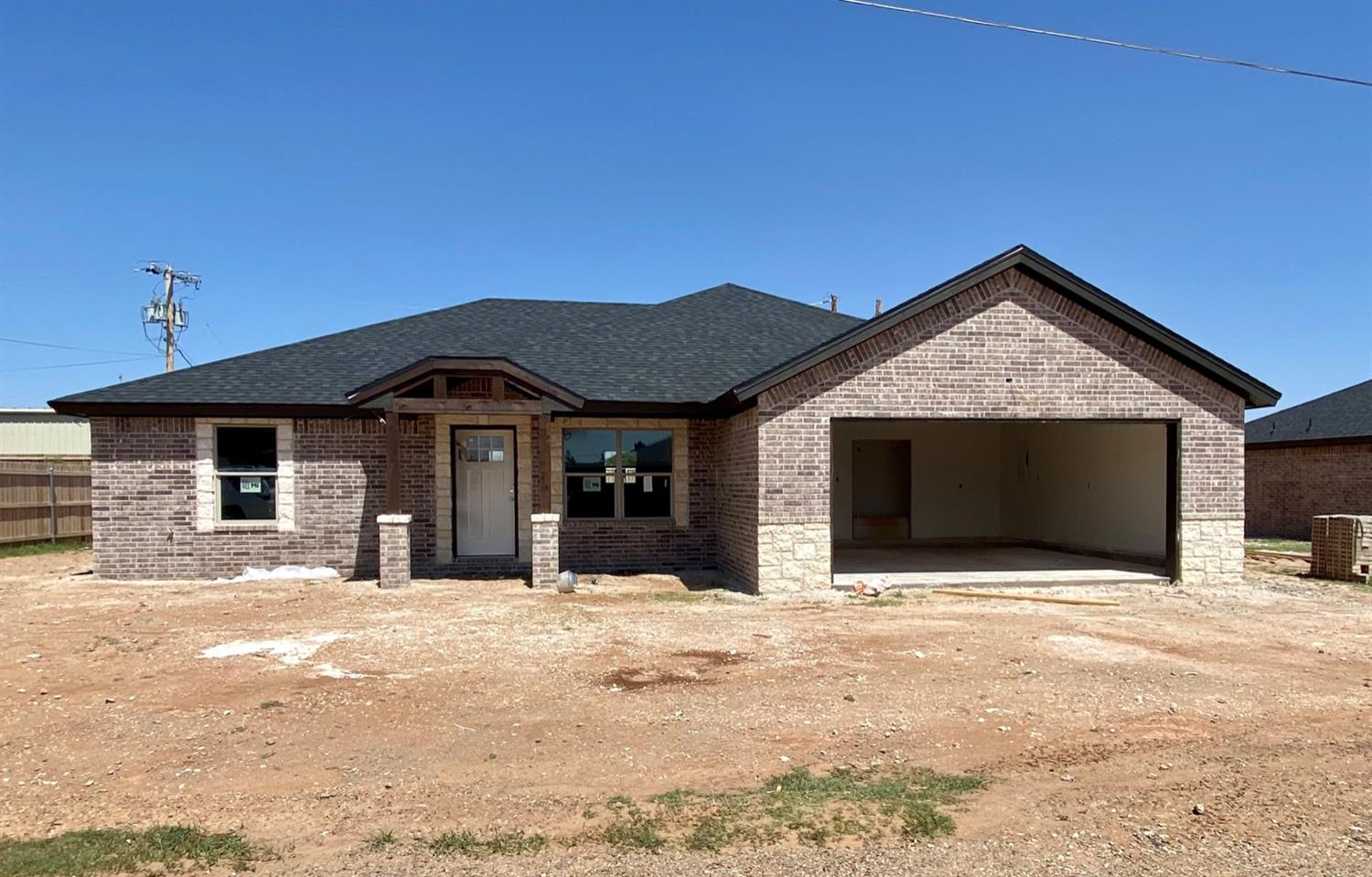 New construction in New Deal! This 3 bedroom 2 bath home is made for entertaining! The open concept living room and kitchen are complete with vaulted ceilings. Escape to a large isolated master that features granite and a walk in closet. Sit on the back patio and enjoy a great West Texas evening! Don't miss this one!