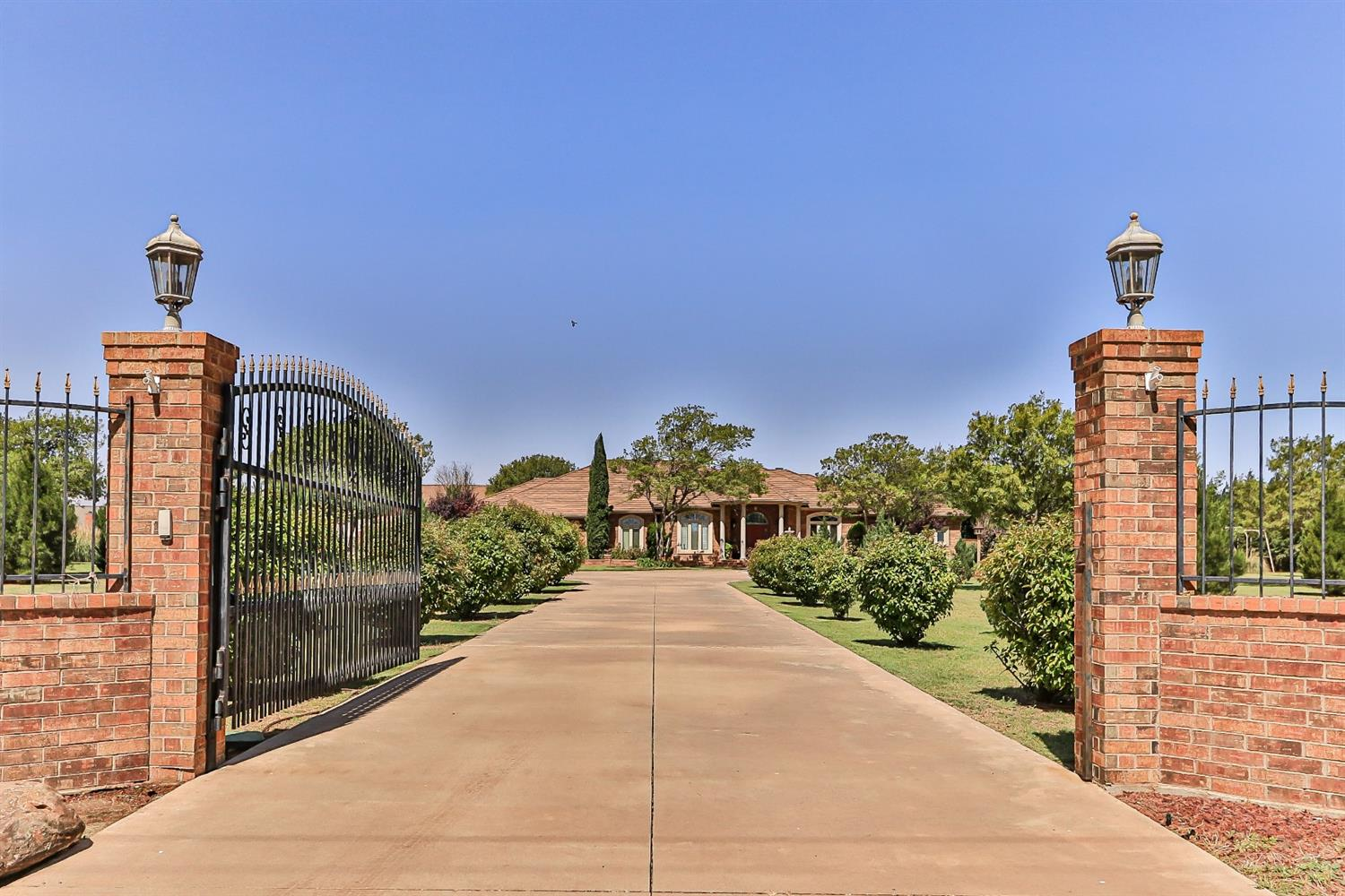 Breathtaking, rare opportunity estate like home off of South Slide Road sits on 2.76 acres. Beautiful gated entry makes its way to the front to a circle drive.  Entire property features 4 beds plus office, split basement with separate media room, covered patio, a pool with a  separate patio, a520 SF apartment, and 2700 SF bricked /shop in prestigious Highland Oaks-Lubbock Cooper ISD. Custom built home features amazing features including special molding and trim. Cooks dream of a  kitchen with double ovens and island. Outdoor kitchen with lots of seating including a gazebo in backyard.  Great place to entertain family and friends. Why not make it yours today.