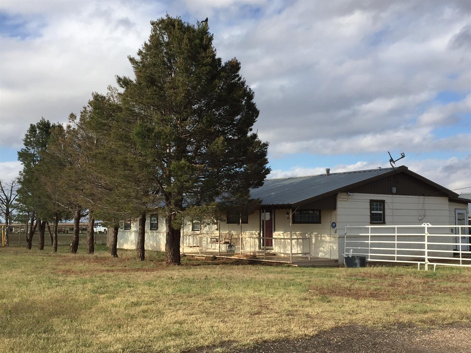 PRIME Horse Property N. Lubb between Shallowater & New D--Lighted 200'x250' Roping Arena--10 stall barn w/ feed/hay room, 5 saddle tack room, pipe fencing, approx 7 acres of pasture, 2 producing water wells, deep sandy arena w/ cattle holding pens at both ends, 15'x20' loafing shed, return alley, 30x60' Metal Barn w/ 30x60' overhang for trailers, hay & equipment, 14'x20' Morgan Bldg, Electrical power & water to barns/buildings on separate meter from house. Frostproof hydrants at stalls, pens & arena. COMPLETELY REMODELED/UPDATED home--NEW submersible water pump, bladder tank & transfer pumps, high-capacity water softener system (2017), 500 gal water storage tank, 30 gal & new 40 gal gas hot water heaters, New A/C 2016, 1070 sq ft detached garage w/ Liftmaster auto door opener easily fits two trucks plus space for lawn mowers, tools etc w/ large storage area w/ built-in shelves/cabinets. Washer, dryer, refrigerator, microwave, water softener, water tank convey.