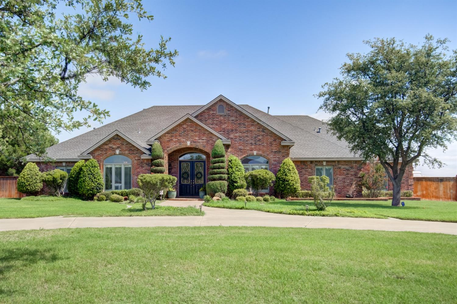 This is a stunning custom built Abbe home on an acre of land in the highly sought after golf cart community of Highland Oaks. Features include a large circle drive, large side driveway for extra parking, 4 bedrooms, 4 bathrooms, 3 car garage, custom shutters, huge entry, beautiful kitchen, hidden pantry, basement, and a bonus room. There is abundant storage everywhere!! Excellent water here!!! Many updates include recent new A/C unit, water heater, new interior paint in almost every room, 3 brand new garage doors, brand new hardwood floors in living and master bedroom, sprinkler system just serviced and has new modern control panel. So many details like triple crown molding, all custom cabinets throughout, built-ins in every closet, walk in closets in every room, and a surround sound system. This is an amazing community of neighbors, maintained by an HOA with a park, tennis courts, walking track, playground, pools, and a clubhouse! Don't miss the opportunity to own this stunning home!