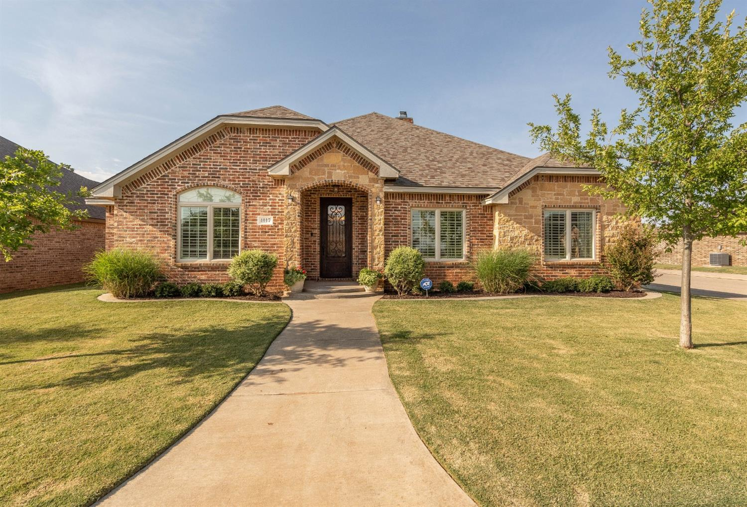 This Home Has Gorgeous Curb Appeal!  It Features A Very Striking Brick/Stone Front Combination, On A Corner Lot, & Beautifully Landscaped.  You Will Be Welcomed In The Large Entry Way Featuring Special Accent Flooring.  It Has A Spacious & Open Floor Plan W/ A Large Living Area, Stately Fireplace W/ Handsome Built-Ins On Each Side; Spacious & Convenient Dining Area; And A Cook's Dream Kitchen W/ Rich Cabinetry Highlighted W/ Gorgeous Granite, Gas Cook Top, & A Wonderful Island W/ Breakfast Bar.  Relaxing Isolated Master Retreat Includes A Beautiful Bath W/ All The Bell & Whistles And A Very Large Walk-In Closet.  Another Bedroom Is Isolated & Conveniently Close To The 3rd Bath. The Other Bedrooms & Hall Bath Are Very Well Arranged. The Interior Includes Many Fine Amenities Such As Plantations Shutters, Lots Of Beautiful Crown Molding, Well Coordinated Tile/Carpet Areas, Many Special Ceilings, & So Much More.  Great Backyard W/ A Wonderful Patio. Rear-Entry Garage. Call Today To See!