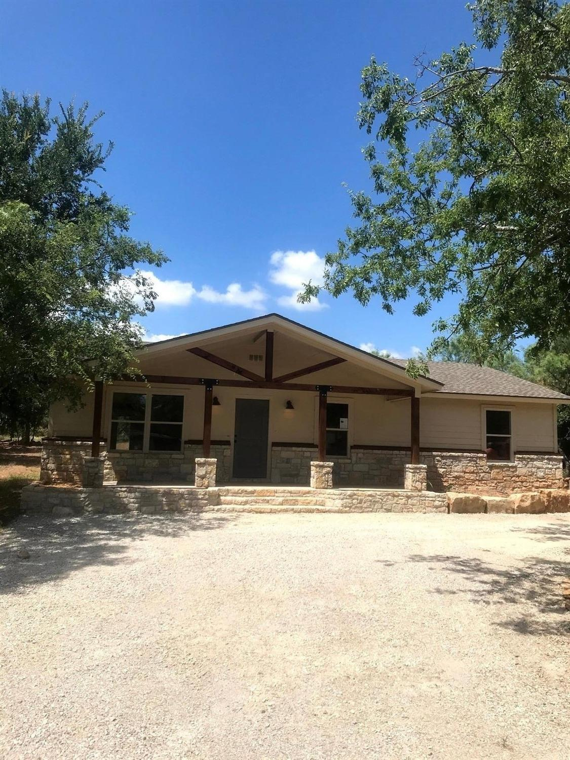 No Fixer-Upper here! Newly constructed home ready to move in & enjoy! Just add your own personal touches!  Wooded lot to sit & relax while watching the wildlife graze.  Water view with all the fun activities of Possum Kingdom Lake close by.  This home is ready for you & your loved ones to start making memories to last a lifetime!