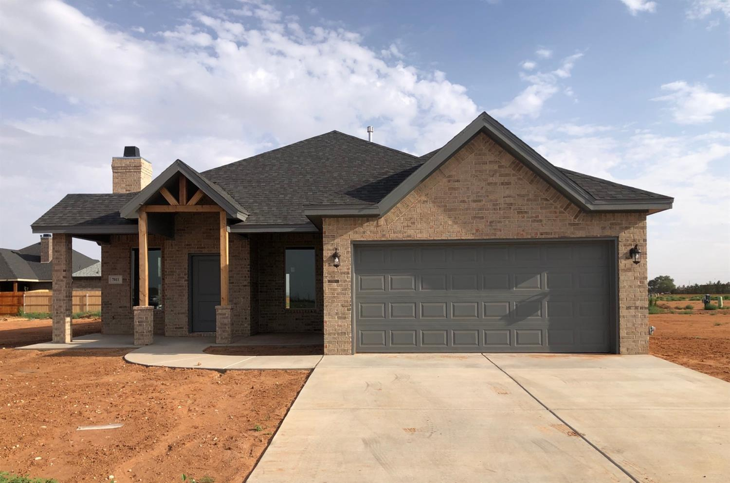 Fantastic 3/2/2 open floor plan with custom wood  accents on ceiling, open breakfast area with island/bar.Sunset Custom Home. If this isn't the home for you, let's build one.
