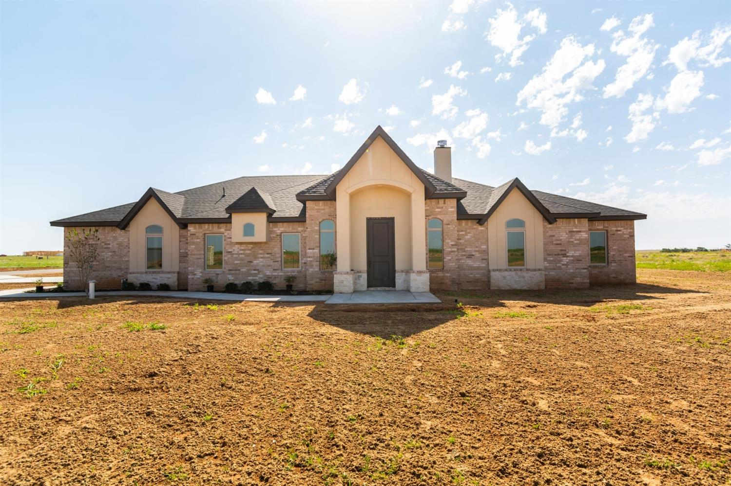 Stunning 4 Bedroom, 2 Bathroom Home in Cotton Creek! Brand New & Ready For it's Family! Located Just South of New Home High School this Home sits on Little Over an Acre with a 30x40 Shop! This Home Features: Tall Ceilings, Floating Shelves, Vinyl Plank Flooring, Open Floor Plan, Granite Counter-Tops, Gourmet Kitchen with Lots of Natural Lighting, Spacious Bedrooms, Secluded Master Retreat, Mudroom and SO MUCH MORE! Head South on SLIDE ROAD (FM 1730) TO New Home about 2 Miles Past the 4 Way Stop. Home is on the left! (EAST)
