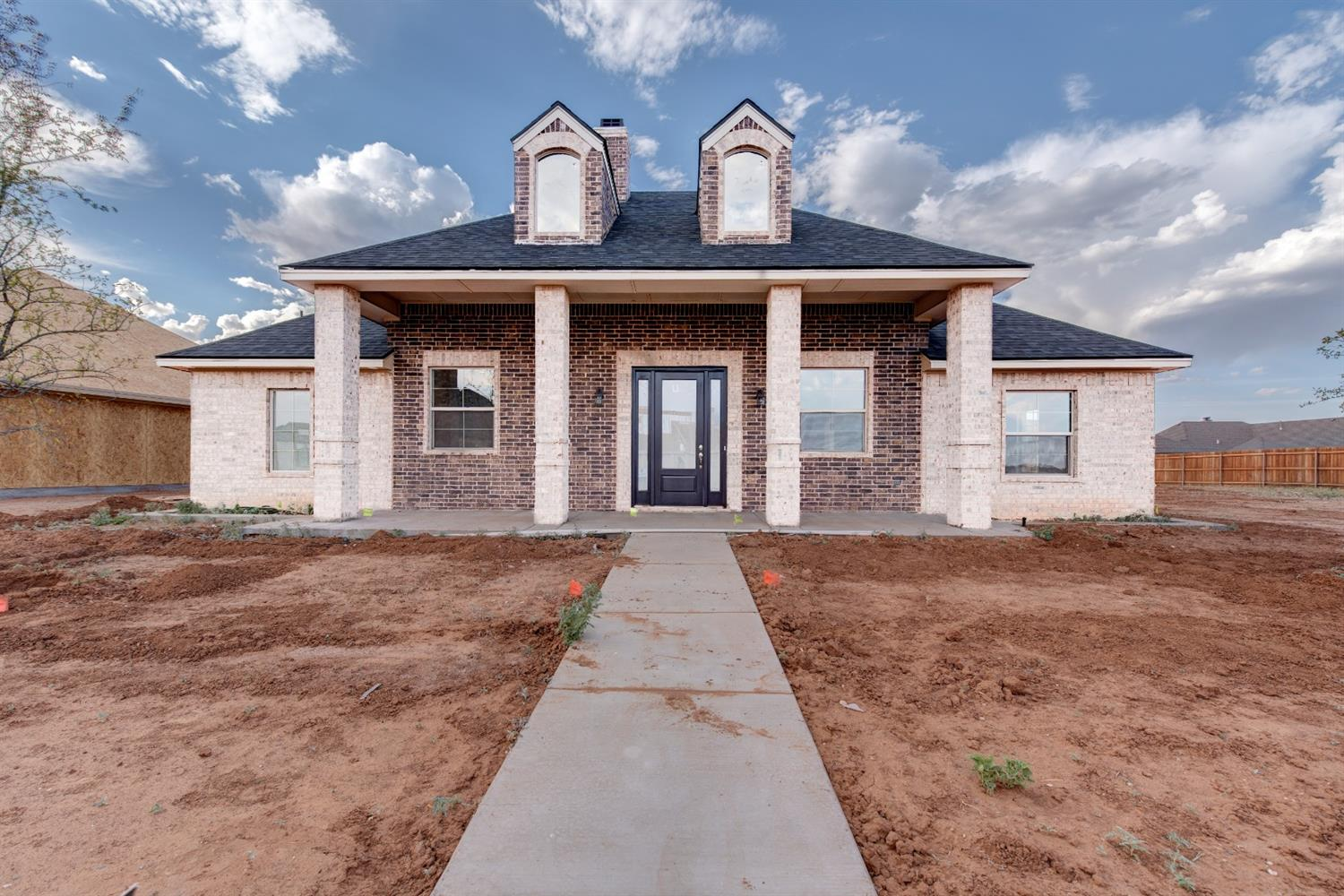 Beautiful new construction on an oversized lot in Frenship ISD. This 4/3/2 offers an open layout with plenty of upgrades. 16' vaulted ceilings, a 2nd isolated bedroom/bathroom, soft close hinges and upgraded appliances. The fireplace is bricked to the ceiling and flanked by built-in cabinetry and floating shelves.The master closet opens to the laundry room. Oversized 20x24 garage with an 8x18' door.