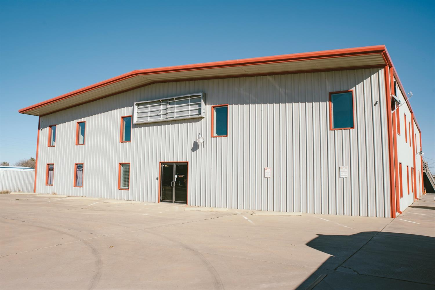 Large office building, shop, fenced yard and back house. The main building includes 24 offices and 3 meeting rooms. All non-MLS brokers/agents will receive 1% commission.