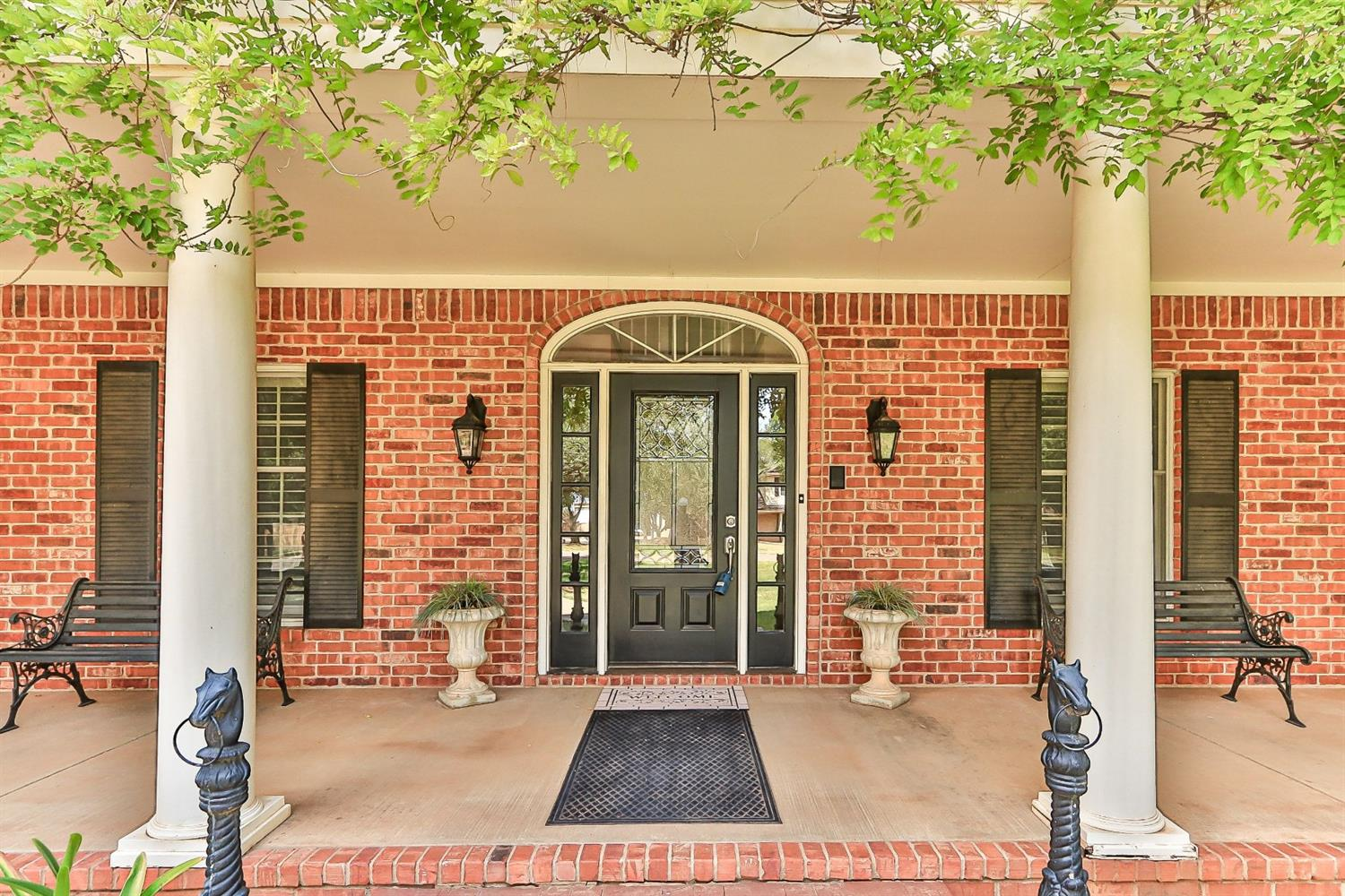 When a Touch of New Orleans Meets a Tropical Oasis MAGIC Happens!The Complete Package in Papalote Estates...Just Under One Acre,40'X44'SHOP plus 14'X44' RV Storage, Frenship ISD-With Strong Southern Roots This Home Will Sweetly Draw You in & Invite You to Stay Awhile-Columns Frame The Entry & Upstairs Balcony-Rich Hardwood Flooring,Double Barrel Ceiling & Two Fireplaces-FOUR Living Areas including BASEMENT & Sunporch that was the Family Gameroom-Dine 3 Ways,Formal,Casual,Bar Seating-Updated Kitchen w/Travertine,Granite,Stainless Appliances,Double Ovens & Induction Cooktop-Elegant Master Suite w/Adjacent Patio...Airflow Tub,Separate Shower,Dual Vessel Sinks,Dressing Area-3 Bedrooms,2 Baths Upstairs + a Cool Hidden Room-Vacation Plans on Hold...No Worries...The Greenhouse is Your Tropical Oasis W/Limes,Avocados,Tangerines & More Surrounding Your In-Ground Pool-Gazebo & More Storage- Gorgeous Iron Gate-So Much To Explore,Discover and Share in This Remarkable Place to Call HOME!