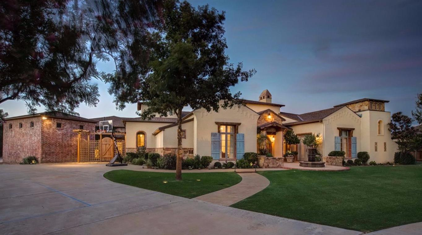 A rare opportunity to own this home built by Jeff Seal that is truly a work of art. Tucked away on a quiet street in the desirable Orchard Park neighborhood on almost 2/3 acre lot, this home offers resort style luxury living.  As you enter, you'll notice the unique touches such as gorgeous wood beams, architectural details, travertine flooring and solid wood doors. The perfect meal for your next dinner party can be created in the kitchen complete with Thermador appliances, spacious island.  Entertaining is a breeze...imagine guests mingling in the bar area, enjoying dinner in the formal dining or in the beautiful outdoor space complete with sparkling pool and abundant patio space. Escape to the Master suite with sitting area, spa like Master bath including separate closets and a safe room.  Your guests will be comfortable in the spacious bedrooms featuring en-suite baths. study.  This home is a must see - make your appointment for a private showing today