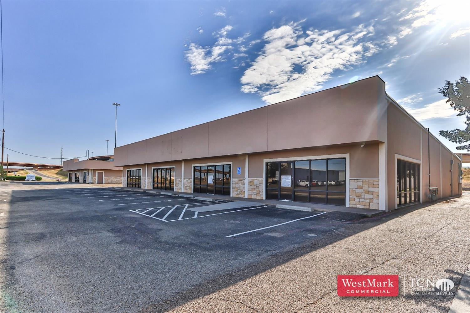 Great location with Loop 289 frontage with 50th street access. Two buildings on the lot 8,000 SF and 3,000 SF. Open concept that can be used as retail or office space.