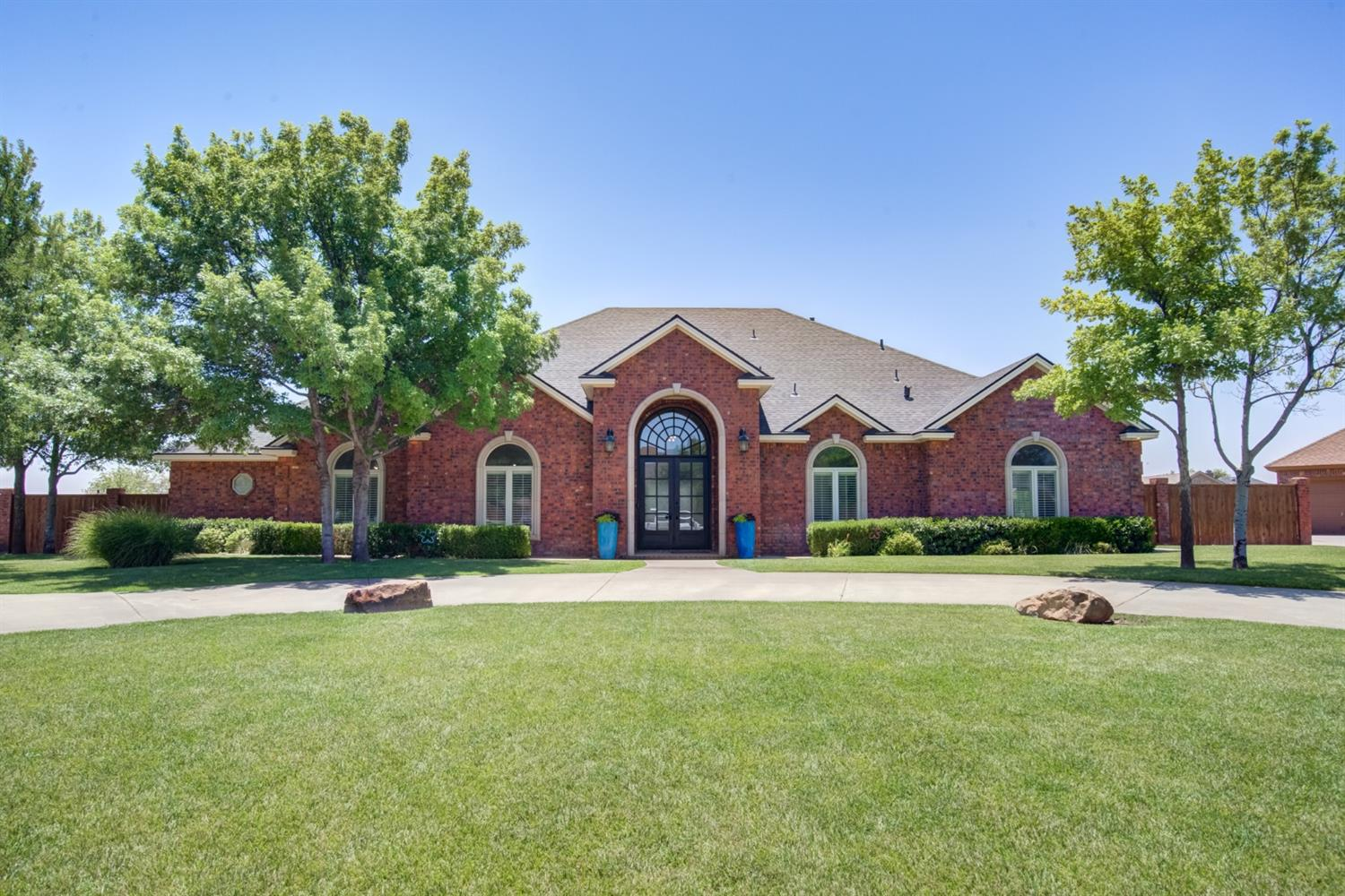 Just in time to get your family settled before Frenship ISD starts school in this beautiful home in Llano Estates. When you pull up into the circular driveway you will see pride of ownership. Enter thru the new 12ft iron door to see the open living room with 14 ft ceilings and corner brick fireplace. Perfect for entertaining, you will like the flow into the kitchen where you see a breakfast bar, island and plenty of granite counter space. Gas stove top, double ovens, microwave, ice maker, lots of cabinets and a huge pantry hidden by a cabinet door. Isolated master suite with large walk in closet, double sinks, separate tub and walk in shower. Other 2 bedrooms share a Jack and Jill bathroom with nice size closets. Basement perfect for movie night or gameroom with a separate closet with lock and key for indoor shop or safe room. Laundry room with lots of space and storage and a hidden access to the attic. 3 car garage, huge covered patio,  close to an acre of land. Plantation shutters!