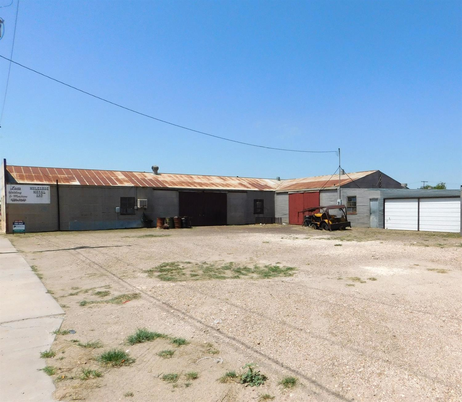 Long-standing Blacksmith/machine shop with shop, office, bathroom and warehouse. Main shop has 4320 sq. ft, warehouse is 600 sq. ft and additional shop space is 720 sq. ft. Property consists of 10 city lots with US HWY frontage, which is the main thoroughfare through Muleshoe. This PRIME location is a rare find in the area. This property is being sold turnkey, with all Blacksmith and welding equipment included in the the price. A detailed equipment list is available through the agent.