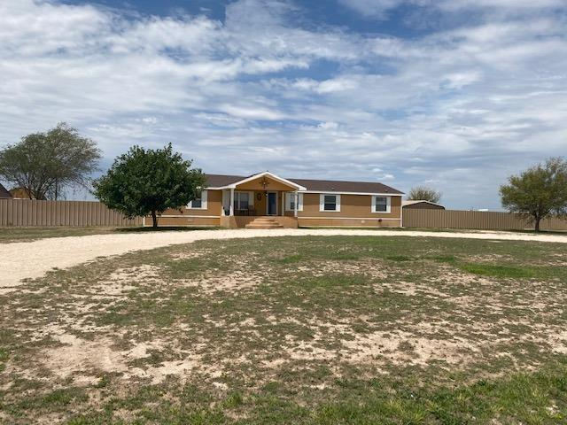 Sitting just over the border in Texas in the Stateline area next to Hobbs offering 4 bedrooms, fireplace, isolated master, ceramic tile flooring, Spacious kitchen, and Corner lot.  This beauty is on 1 1/2 acres fenced in backyard with multiple outer buildings for storage and a 2 car carport --You'll love all this land!