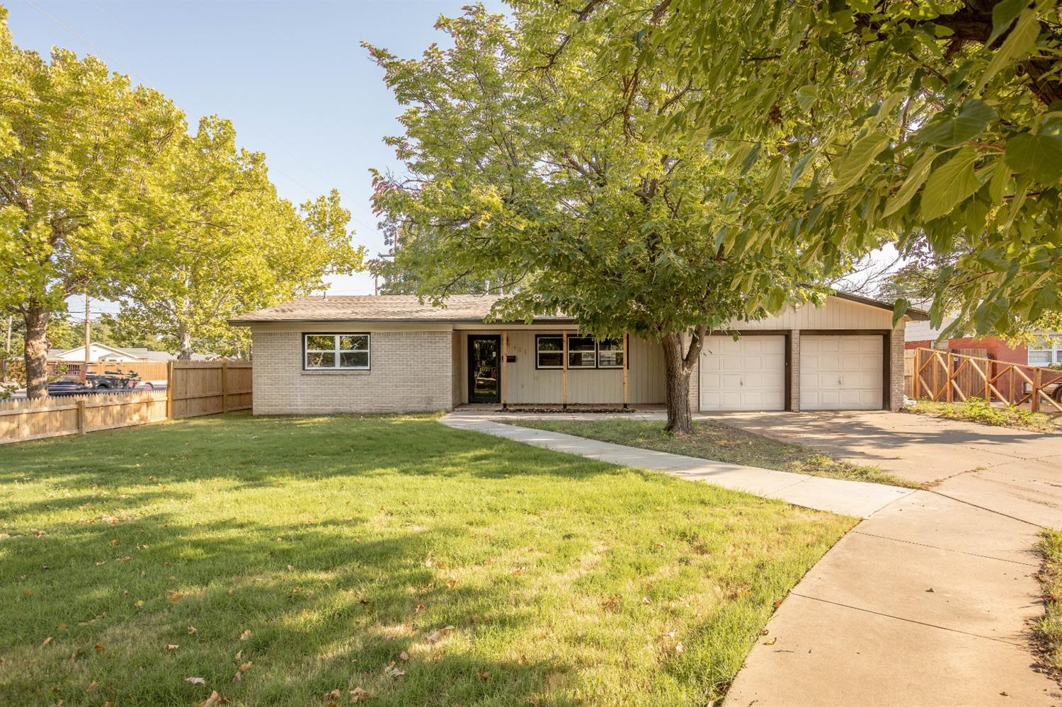 Completely updated! You will feel like you are walking into a new house in a beautifully mature neighborhood! 2 living areas open to the kitchen with a separate office area too! Call your favorite REALTOR today to see this one!
