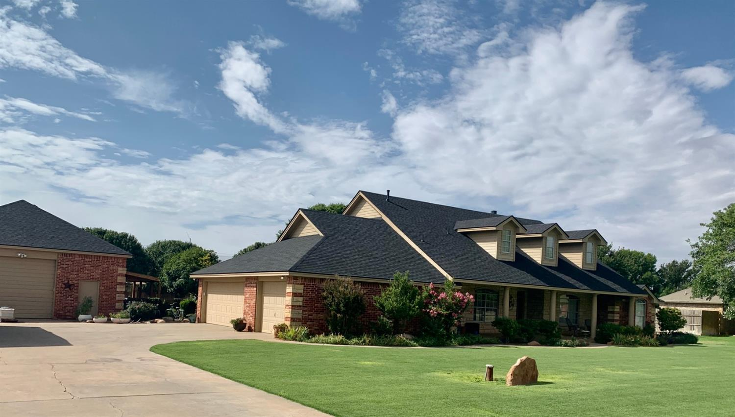 You can have it all! This remarkable home in Pine Grove Estates has 5 bedrooms, 4 bathrooms. Great open concept inside. It sits on almost an acre, and the backyard is prime for outdoor life, with a 30'x30' shop and 35'x17' man cave included. New roof installed week of 7/15/2020