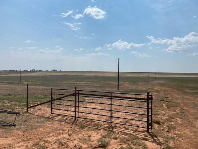 REDUCED $15,000! 162 acres of grassland in Blackwater Draw just North of Loop 289 on University. Entire property is fenced with pipe fencing, T-posts and hog wire and steel post corners. House is a 2/2/4 car carport and is being updated. Recent metal roof. Isolated master. Living area is large with wood-like flooring and 10- person bar and walk-in pantry. Skylights and ceiling fans. As a bonus there is a zip line! 1/2 mile highway frontage on University. Privacy of country living but minutes from Lubbock.