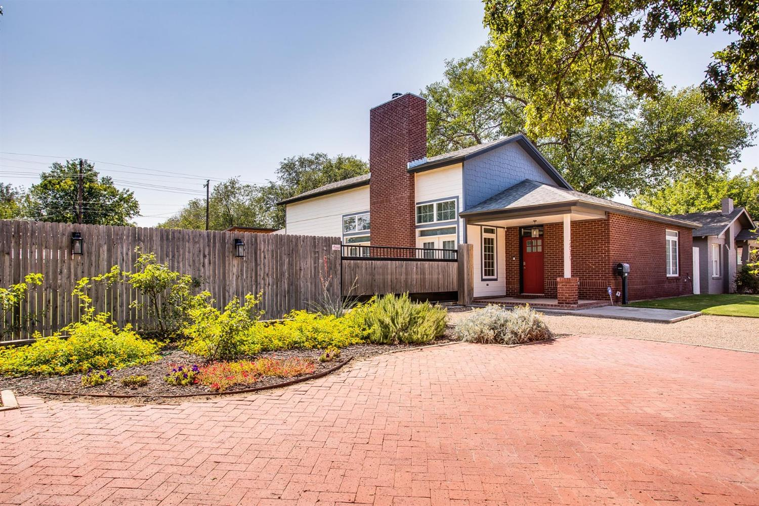 One of a kind gem in Tech Terrace. A custom build completed in 2017 on two separate lots, making this listing one of the most unique properties near TTU campus. The front entrance leads into a stunning 19 ft vaulted living area with a cozy fireplace and stained concrete floors. The remaining rooms with 10 ft ceilings add spaciousness throughout. Interesting features include a safe room engineered by the Texas Tech Wind Department, no hallways ensuring no wasted space inside, and master bath skylights for soft natural lighting. The connecting lot, which is tucked in behind a 7 ft. privacy fence and electric gate, has a covered RV space with full hookups (water, electric, and sewer), and plenty of space for whatever you can imagine. Come check out this one of a kind home today!