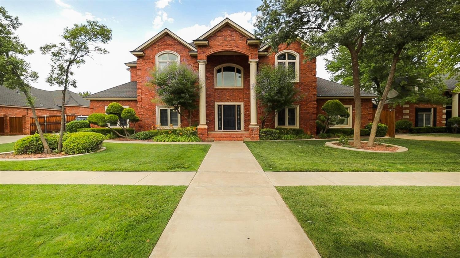 **MOTIVATED SELLER** Gorgeous 5/5/3 home with basement/media & game room and pool! As you enter this beautiful home, you will notice an amazing spiral staircase stretching toward a soaring 20' ceiling and new flooring throughout the first floor. The living room offers a gorgeous paneled coffered ceiling. The spacious, open-concept kitchen features beautiful new granite countertops & backsplash, breakfast bar and island. The isolated master suite provides a tray ceiling, private access to an outdoor living space, double vanities, airflow tub, separate shower & large walk-in closet. The 3 secondary bedrooms are each isolated with their own private baths. This home also offers a beautiful office space right off of the entry. The spacious basement features its own heating and air system. The amazing backyard includes a  large covered patio, in-ground pool, hot tub & storage building.