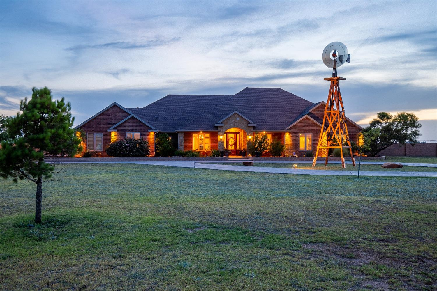 LUXURY custom, West Texas dream home on 3 ACRES! Room to roam... This home has it all! Luxury life with beautiful sunset and sunrise views right outside each window! Peaceful, isolated and yet perfectly situated in Frenship School district. 5 bedrooms, 4 full bathrooms, 3 car oversized garage, 3 fireplaces, 2 spacious living areas, study, basement/media room, salt water Bahama Beach pool. This home boasts two dishwashers in the kitchen! The  media room furniture and projector convey, as well as refrigerator/freezer in kitchen and the washer+dryer. Well pump, bladder and power all new in 2020. Welcome to your picture-perfect West Texas Dream Home!