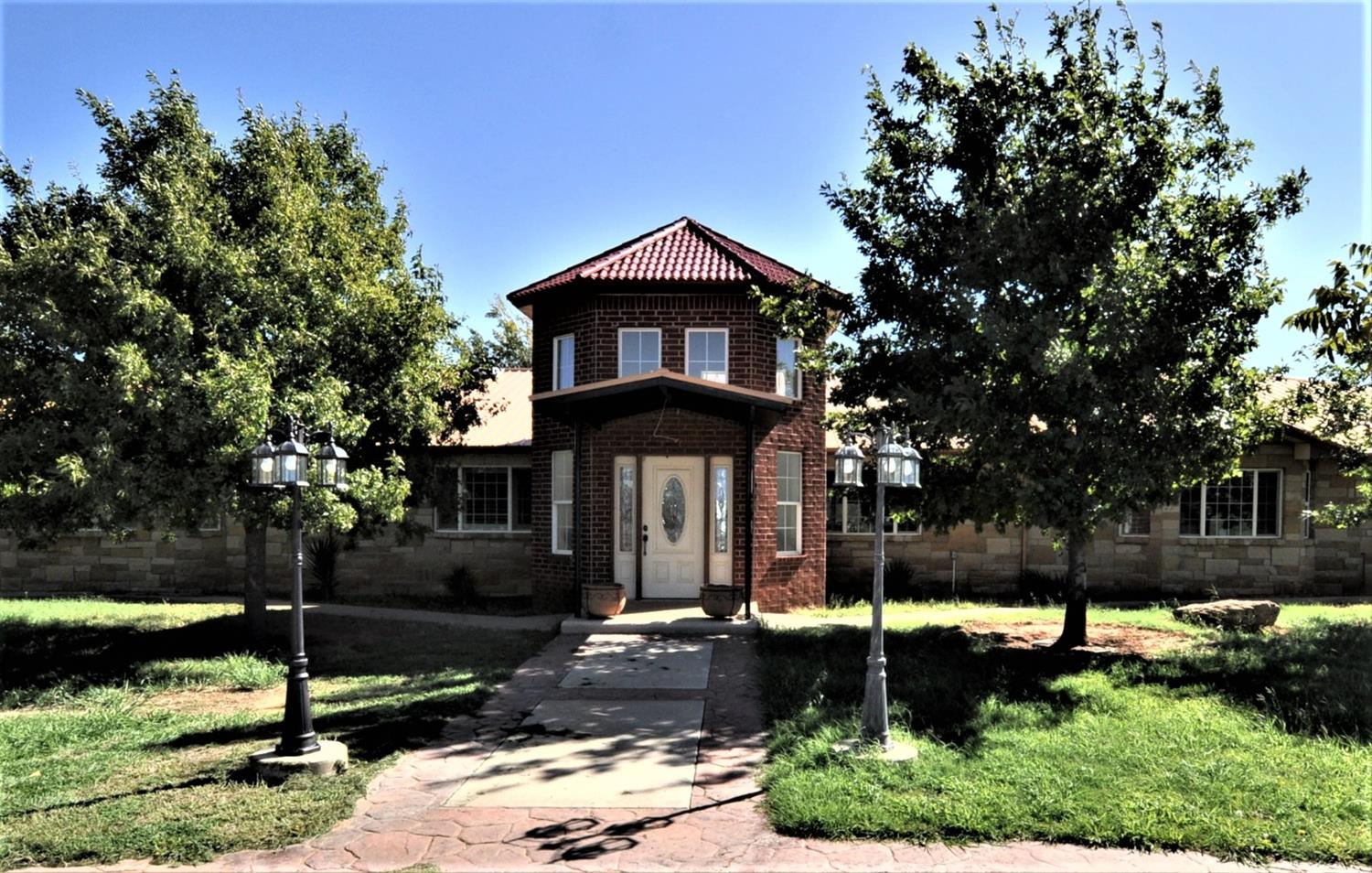 Beautiful 4 bedroom, 4 1/2 bath home in Levelland on 11.9 acres of land. This could be great horse property or great for a home based business or both. Property is all fenced for animals. Currently there are no restrictions, buyer could create restrictions if desired. Home has many great features, large bedrooms and bathrooms, huge kitchen with 2 pantries, huge laundry room with hookups for 2 washers and 2 dryers, half bath in laundry room, master bathroom has large walk-in shower, his and her sinks. Huge basement would be great for game-room/media room. In the backyard we have a nice covered porch, 3 car garage and large carport, pool that is currently not used, nice 2 story structure that could be a gameroom. There is also a gazebo and stone fireplace. There are a lot of different kinds of trees including about 200 pecan and 100 fruit trees and are on drip system. Concrete driveway goes all the way to 2 20x60 barns. Pond is currently not filled with water.  Sq footage is approximate.