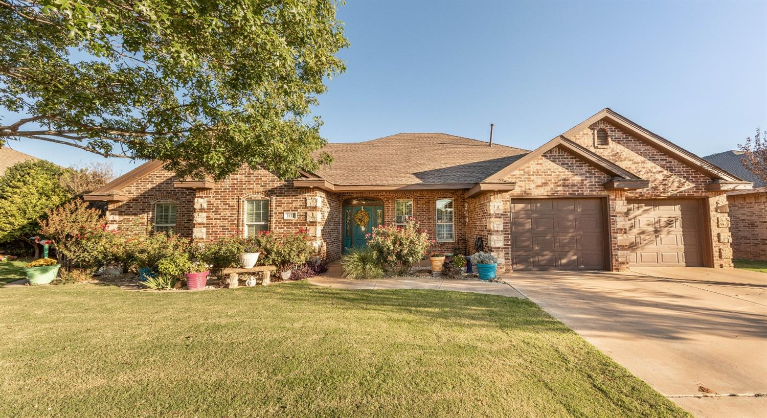 Small town living at its finest! Shallowater offers peaceful living near all that Lubbock has to offer. 4/3.5/2 This one is a classic beauty! Pretty hardwood & tile flooring! The trim/woodworking throughout is outstanding! Mature landscaping, trees and a gracious front porch create beautiful curb appeal. Separate dining room! A huge kitchen opens to a dining area and a large living room with very nice built ins that flank the fireplace. The basement is the perfect movie room/workout room/playroom....The large master suite is isolated creating a private retreat. Out back you'll find a gorgeous covered patio/pergola, a dog run, a newer fence, and lush grass.  Don't miss the separate apartment out back that could work as a mother-in-law suite, a man cave, craft/sewing room, office, etc... lots of possibilities! Apartment has a FULL kitchen/bedroom/bathroom/laundry room.