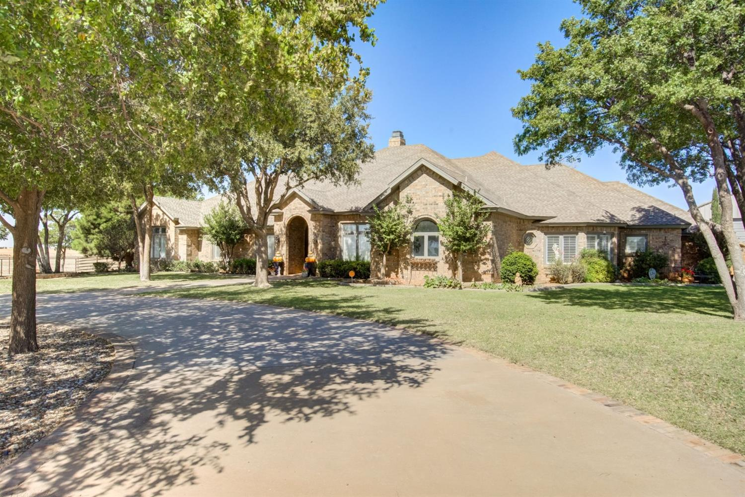 This beautiful home in Buena Vista Estates is one of a kind. On more than one acre, you'll find 2 horse stalls, a large barn with a full, separate apartment, and views that will take your breath away. This house features gorgeous hardwood floors, granite, and upscale accents. The Master Suite opens out to your private patio, and the bathroom is a dream come true - complete with separate shower and soaking tub.There's also a dedicated office space, perfect for working from home. Entertaining will be a breeze with the perfect-size wet bar off the patio, and a second living area/game room/theatre room upstairs. Custom built-ins, crown molding, two fireplaces, surround sound, prep sink in kitchen, and all the extras are found here. Schedule your exclusive showing of this house today.
