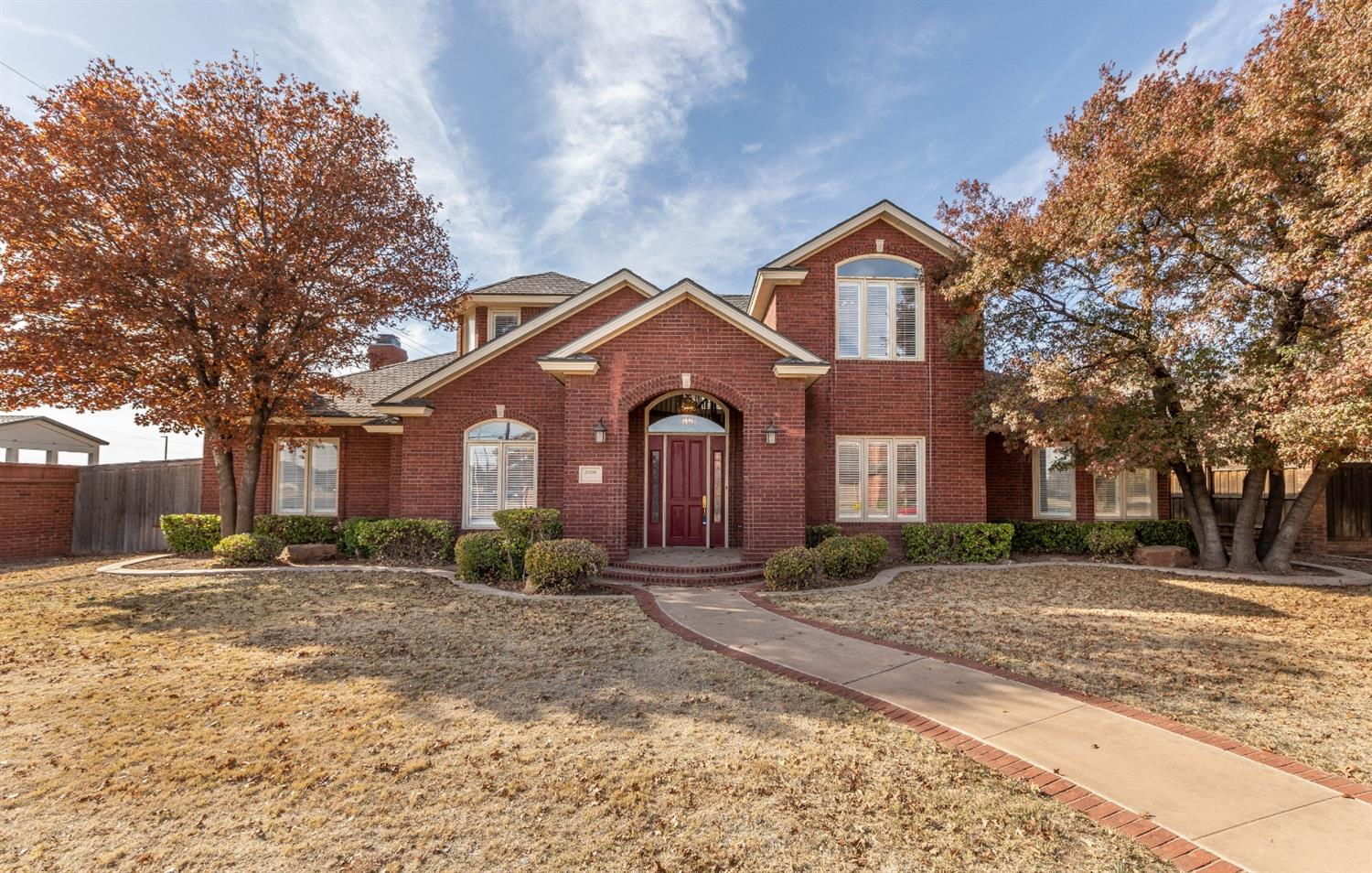 You would like to have lots of natural light & tall ceilings but new construction prices are blowing your mind? You need 4+ bedrooms and several living areas but can't fathom paying Cooper/Frenship taxes?  SW Lubbock is a must but want the feel of an established neighborhood?  Here's your ideal opportunity in this stately 2-story in LakeRidge - priced to sell at only $100/sqft!! Multiple living spaces inc kids area/loft (17 x 15.5) on 2nd floor, wood-floored gameroom/MIL suite on first floor. 4 full baths + a 1/2 bath for guests. Each bedroom is huge and has its own bathroom- one upstairs with 10 x 9.5 area. Nice built-ins throughout. Two lovely fireplaces. The backyard begs for a pool and there's plenty of space for it. 3 car garage! Opportunity knocks!