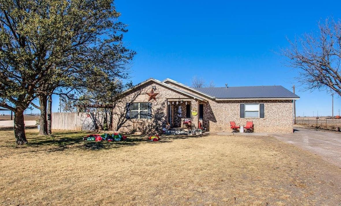 Awesome 4 bedroom home with a shop and cattle barn/run that sits on 11.6 acres right outside of Levelland! This home has hardwood floors throughout the living room and dining area. The kitchen has been updated and has a large island that does convey. The main bedroom has double sinks, separate tub, separate shower and a walk in closet. There are three remaining bedrooms and one of them could also be used as an office. This property has two 30 X 60 shops with overhangs. One shop is set up to run cattle with 6 stalls, 3 runs, automatic watering system, wash room, bathroom and more. The second shop has two garage doors, one of which is electric. This property is perfect for anyone with cattle, show cattle or horses. Call us today to see this one before it is gone!