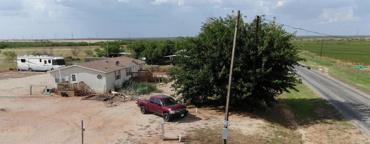 This Mobile home is in unincorporated IRA, TX. Built in 1998, this property features 3 bedrooms, 2 bathrooms, 0.98 acres, and 1,568 sq. ft of living space. The property is surrounded by 20 RV rental spaces that rent out for $375 per month.    This property is located less than 1/5 of a mile from the Ira School. IRA school is classified as a 1A school by the UIL. It is part of the Ira Independent School District located in Scurry County.