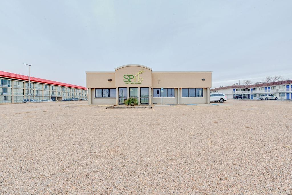 2nd Generation restaurant space now available on the access road of I27 near S Loop 289. Most recently used by the South Plains Food Bank to prepare daily meals, this property has it all!    Boasting a walk-in cooler, walk-in freezer, wash room with mop sink and a washer/dryer, and an additional heated and cooled storage building; this property is perfect for a restaurant.    The space is currently separated with office space up front and a very large, commercial kitchen in the rear. The office space could easily be changed back to an open dining area. However, much of the kitchen could be further demised to meet the needs for additional office space and no kitchen for a non-restaurant user.    The entire 1.77 acres is gated which could be used for a secure stack yard, additional parking, or additional buildings if needed.
