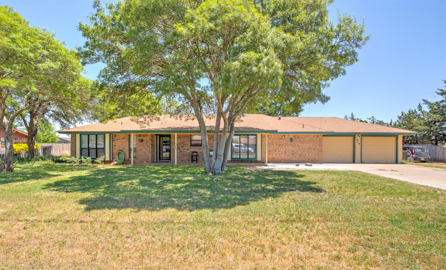This beautiful ranch style home is located just outside of Levelland.  It is a 3 bedroom 2 bath home.  The large living area is so inviting and the sunroom is an added bonus!  This home sits on almost an acre of land and has a horse barn with 2 stalls, a tack room and corrals.  Call today to see this property!