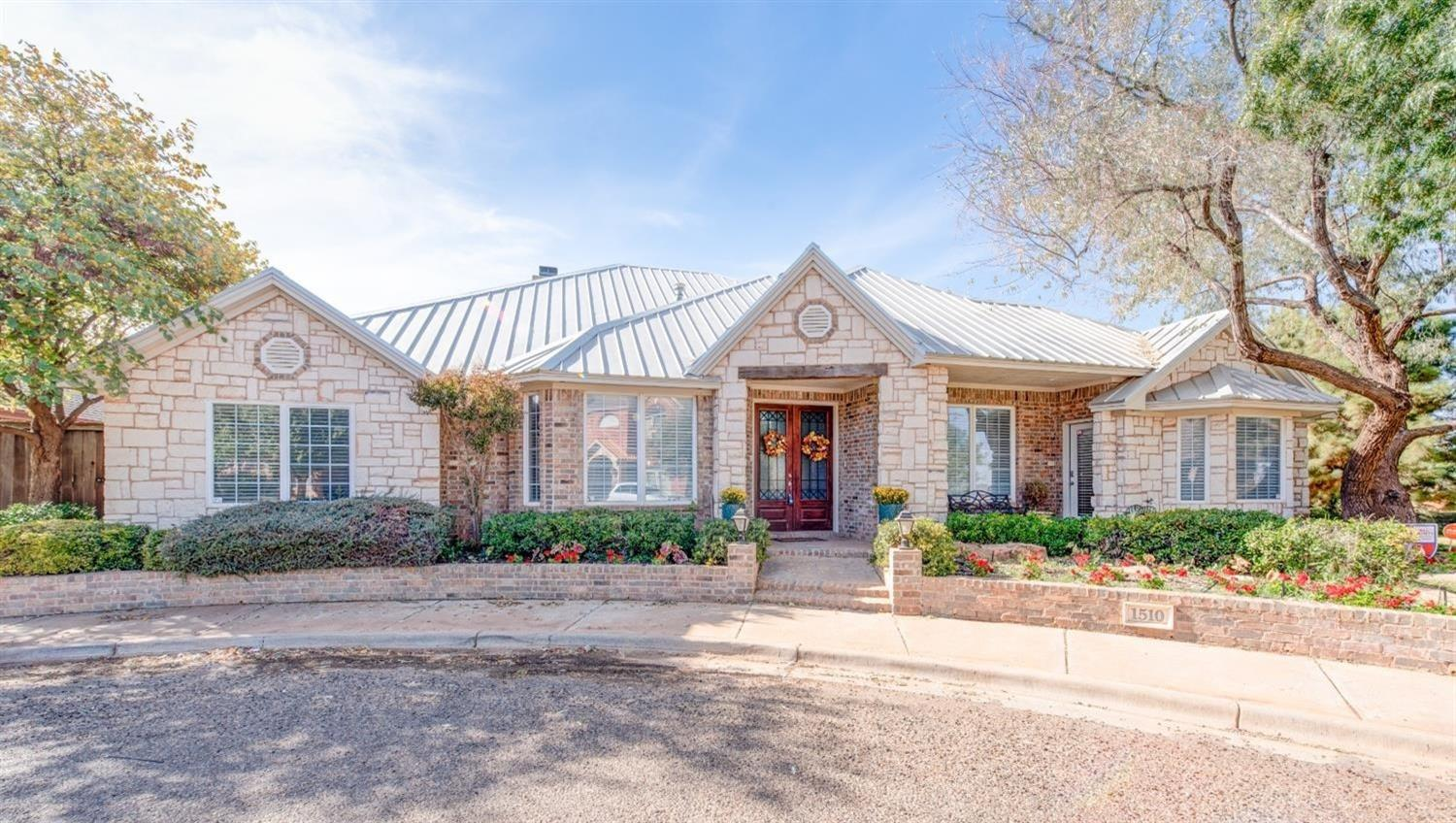 Tired of seeing the same house over and over in Lubbock? Look no further! This former Parade of Homes winner in Preston Manor is simply one of a kind. Situated on a quiet cul-de-sac, this home looks like it was plucked right out of the Texas Hill Country. A standing seam metal roof adorns a well-appointed exterior surrounded with Austin stone. The main living area has a soaring ceiling with open trussed cedar that flows effortlessly into the outdoor patio. High end custom touches can be found throughout the home, including: Three separate fire places. Surround sound throughout. A master closet that functions as a safe room. A separate 3rd car garage. Two living areas and an office/bonus room. And the list goes on and on. All of this is situated in Lubbock's premier master planned community with a swimming pool, tennis courts, trails, parks, beautiful club house with fitness facility, dog park, and more. Do yourself a favor and come see this house in person. You won't be disappointed