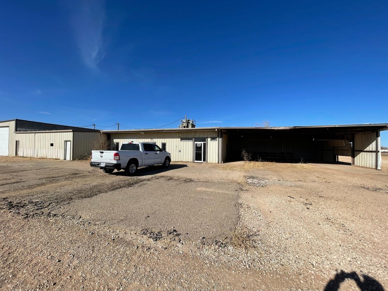 Rare opportunity! This commercial property comes with a lot of space for the money. Has several small offices up front, with a common area. Also included is over 4000 ft of metal shop, some built in 2018. Also has about 8.5 ACRES of caliche the property sits on. Has been used for multiple purposes, most recently for trucking.