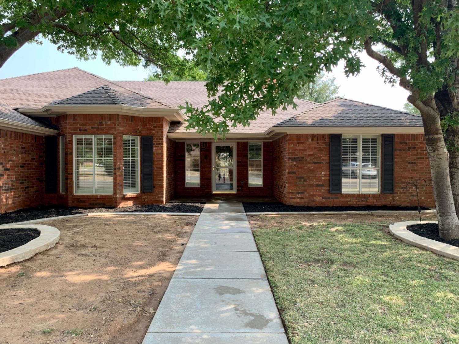 One owner of this 3-2.5-2 with basement, formal dining, and heated and cooled sunroom.  Plenty of storage, oversized garage, double ovens, plantation shutters, built-ins and many extras! Fresh paint, no wall paper, and new flooring!  Recent roof!  Be sure to see the RV parking on the southside of the home behind the fenced area. Built by Robert Woods!