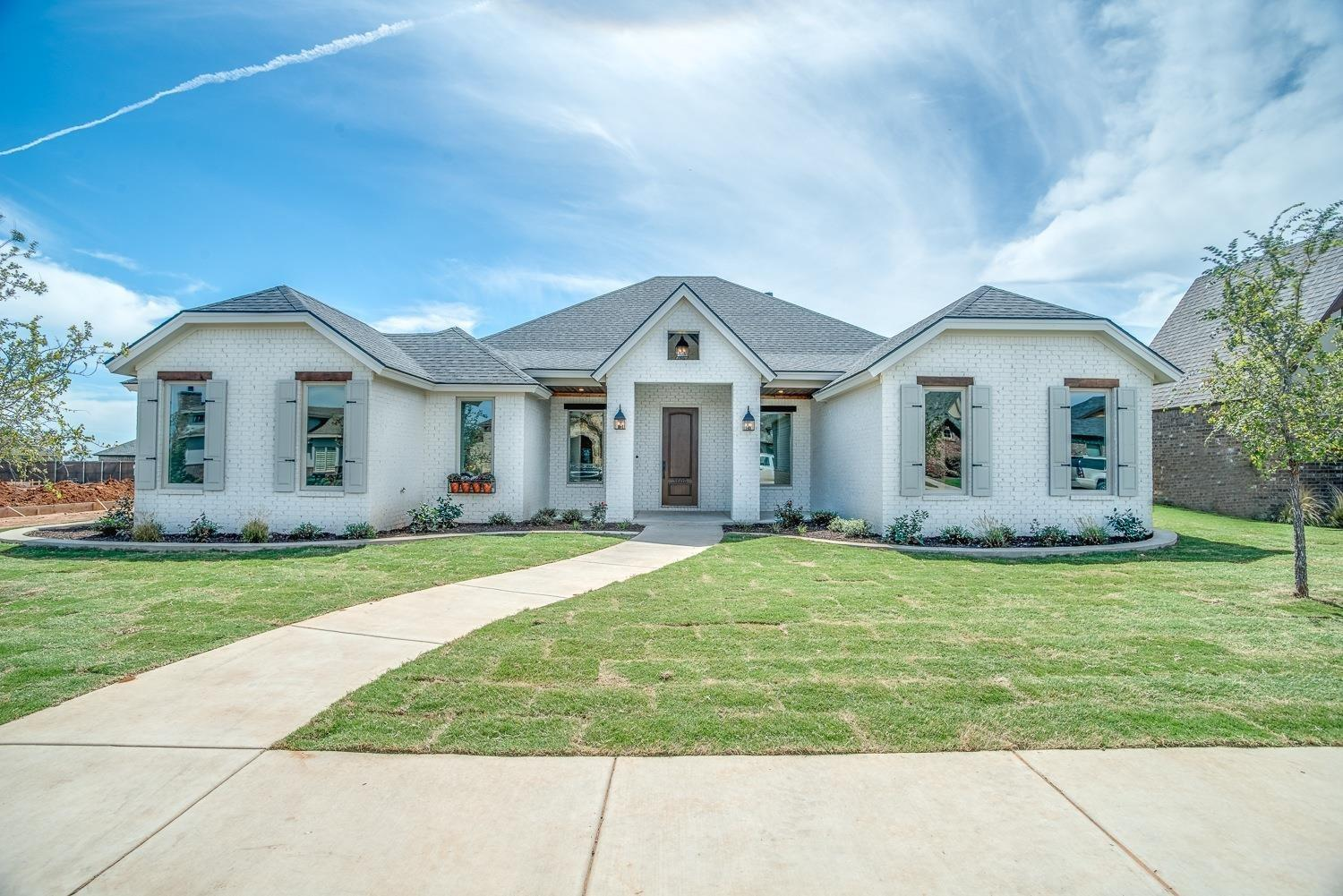 Modern Manor style Home in Kelsey Park!Lubbock-Cooper ISD! This Open Design has 4 bedrooms, 3 baths, Large Living, 10ft soaring ceilings, fireplace, spacious dining, open kitchen with island, isolated master retreat, luxury bath.  A must see! Close to Park with walking trail.  Immediate possession available.