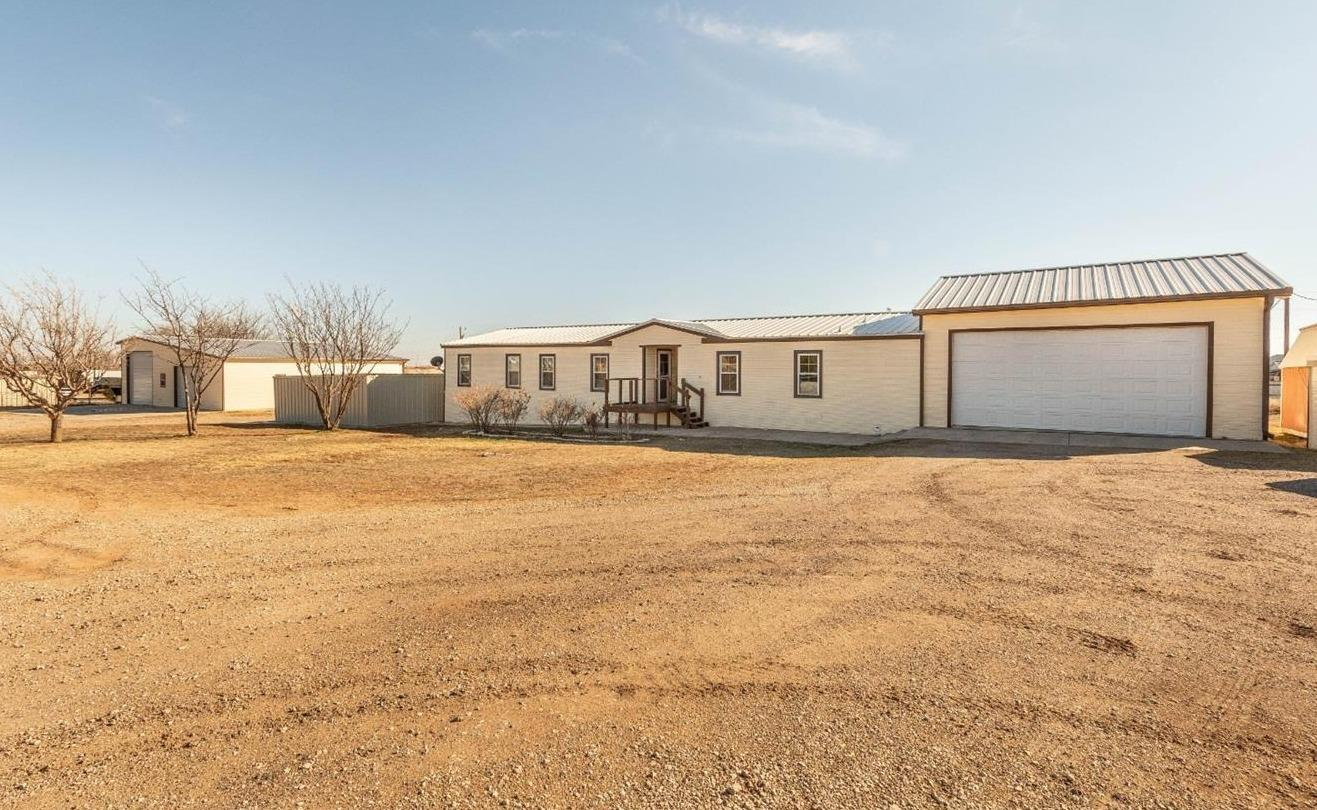 Great property on 1.9 acres in Lubbock Cooper ISD. 50 x 50 fully insulated, heated &cooled shop with 1/2 bath. Main house is 4 bedrooms, office, 2.5 bathrooms, new kitchen addition, and formal dining room or second living area. Whole house has been foam insulated including garage. 2, 5 ton HVAC units service house and oversized garage. 1 bedroom/1bath handicap accessible apartment added to the back of the house.  Shop has two 14ft doors perfect for pull through RV parking. 2 car garage has extra workshop space with cabinetry. Huge covered patio with hot tub.