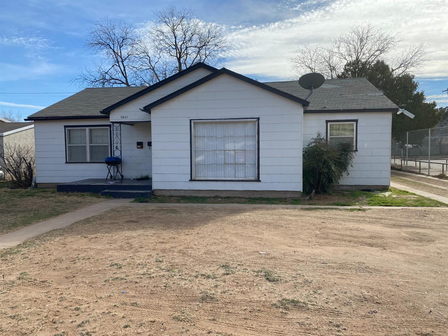 Rental with lots of space. Two living areas or second living area could be used as an office. Nice sized galley kitchen with double ovens, pantry & gas drop in range. Central HVAC. The garage apartment is rented for extra income. This is an ideal property for investors that has good clean appeal.